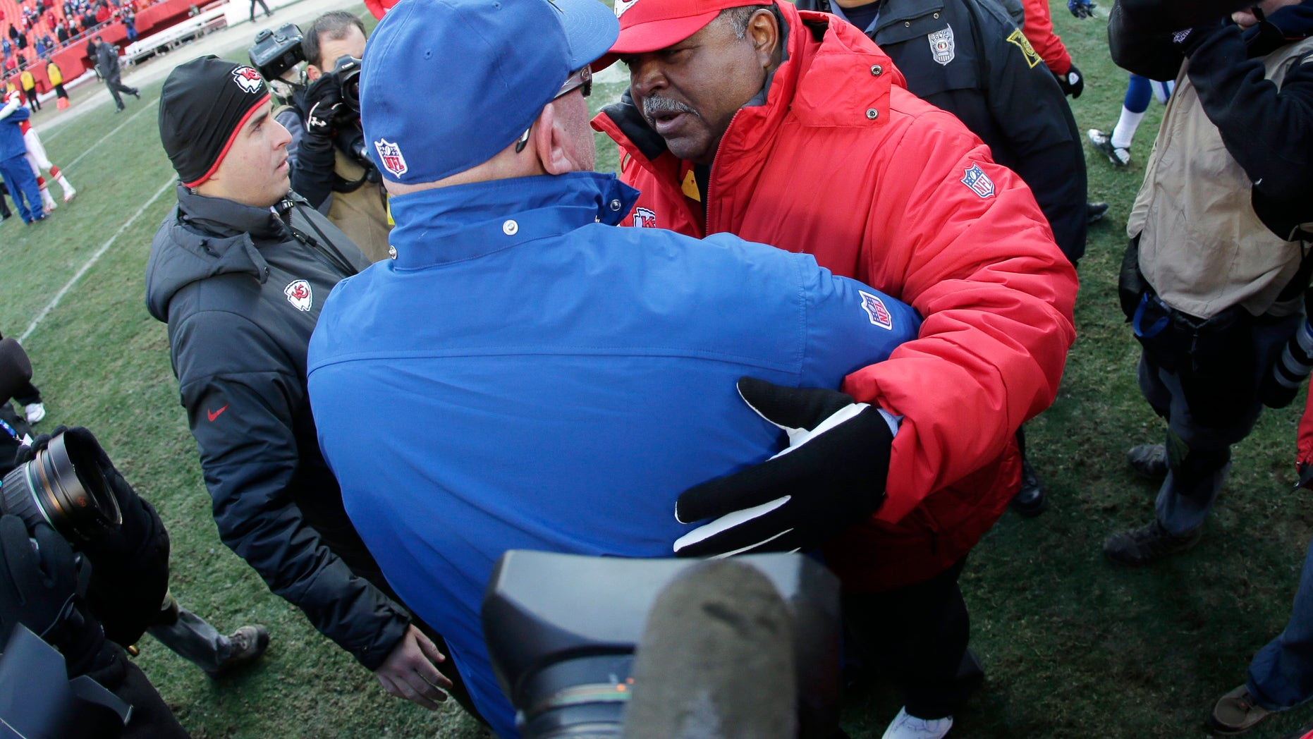 Indianapolis Colts interim coach Bruce Arians, left, talks with Kansas City Chiefs coach Romeo Crennel after an NFL football game Sunday, Dec. 23, 2012, in Kansas City, Mo. The Colts won 20-13. (AP Photo/Charlie Riedel)