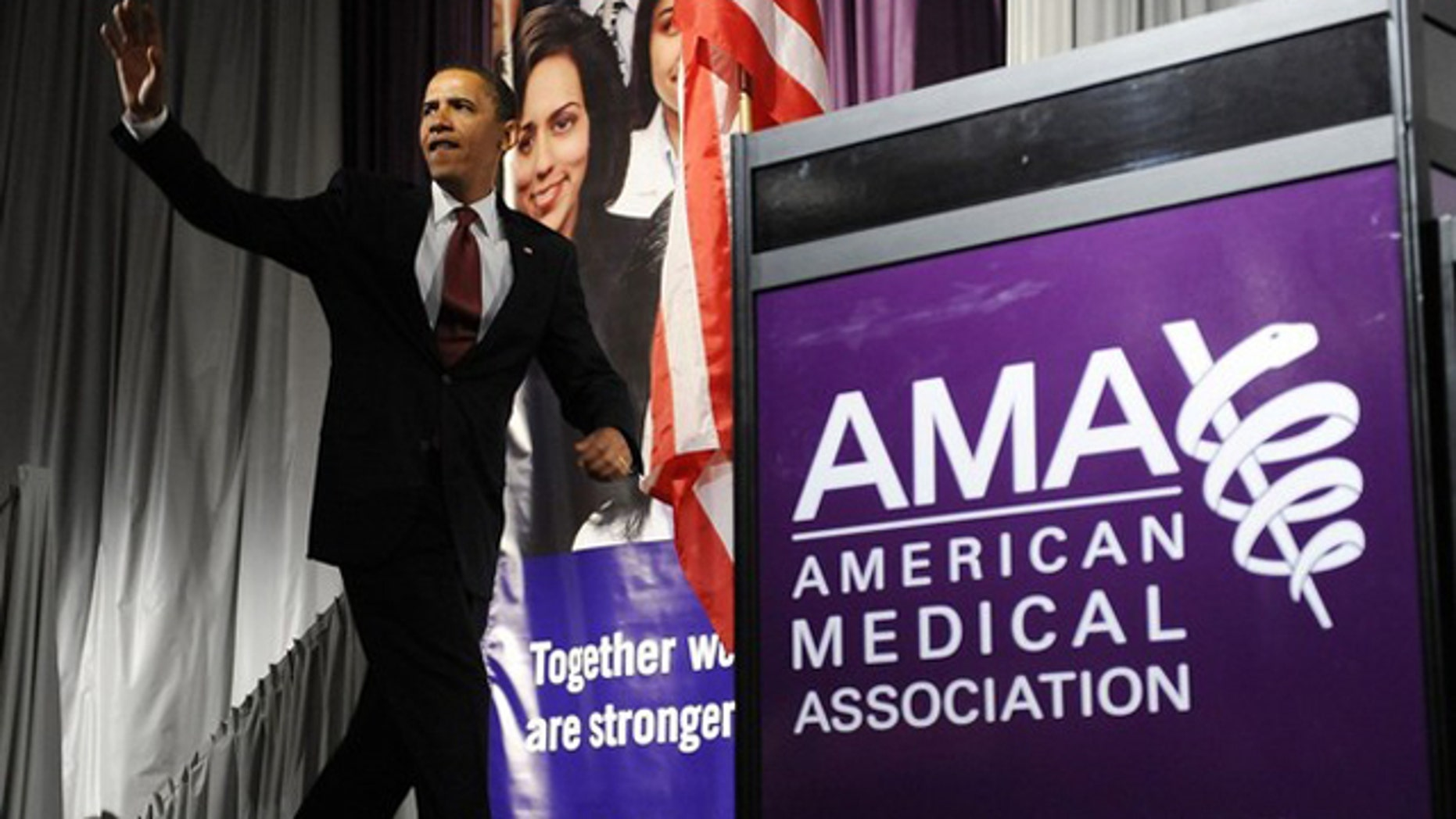 In this June 15, 2009, photo, President Obama arrives to deliver remarks on the health care system at the annual meeting of the American Medical Association in Chicago.