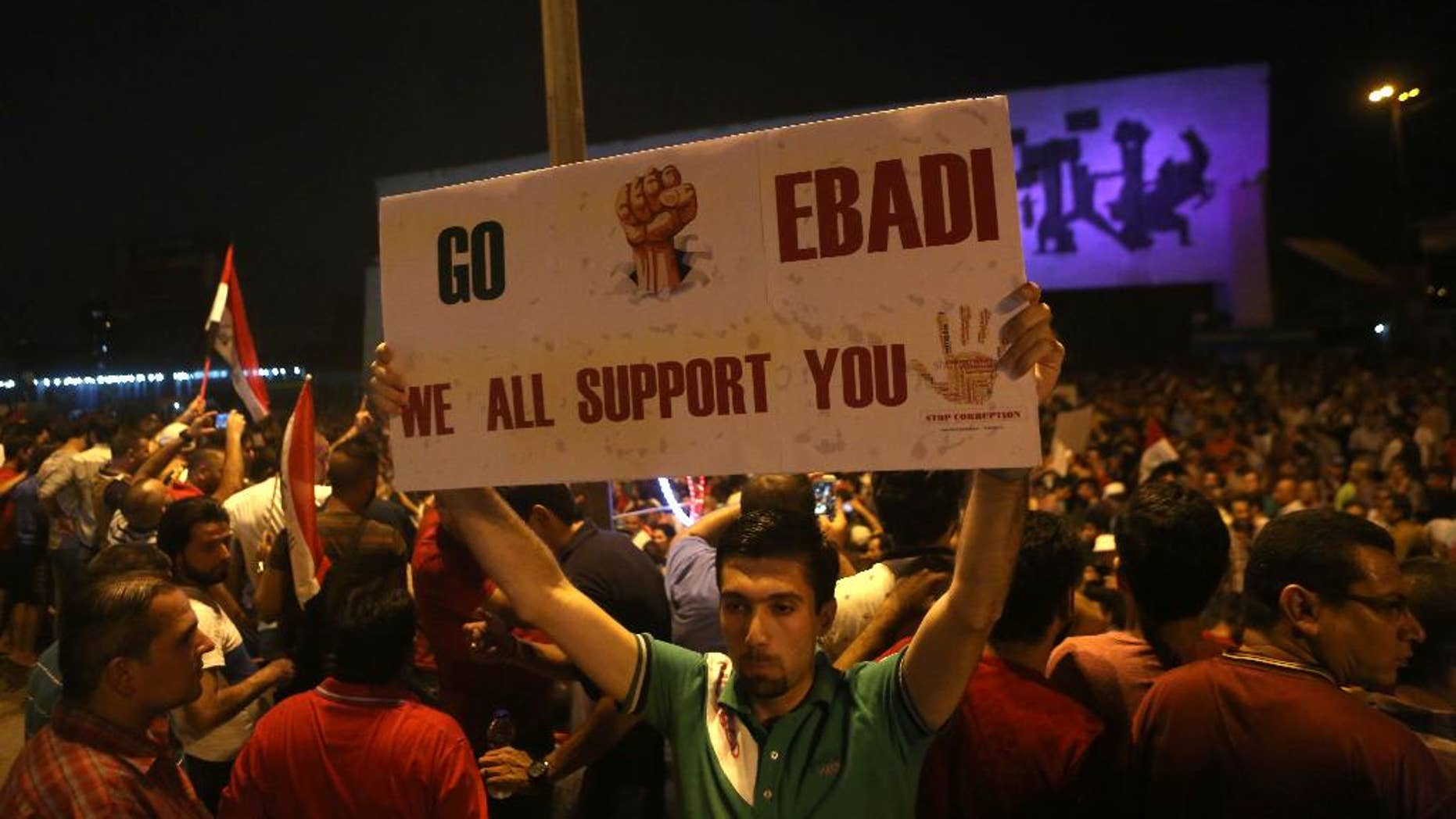 Demonstrators chant in support of Iraqi Prime Minister Haider al-Abadi during a demonstration at Tahrir Square in Baghdad, Iraq, Sunday, Aug. 9, 2015. Iraq's prime minister unveiled a bold plan Sunday to abolish three vice presidential posts and the offices of three deputy premiers, hoping to cut spending amid mass protests against his government as the Islamic State group still holds a third of his nation. (AP Photo/Khalid Mohammed)