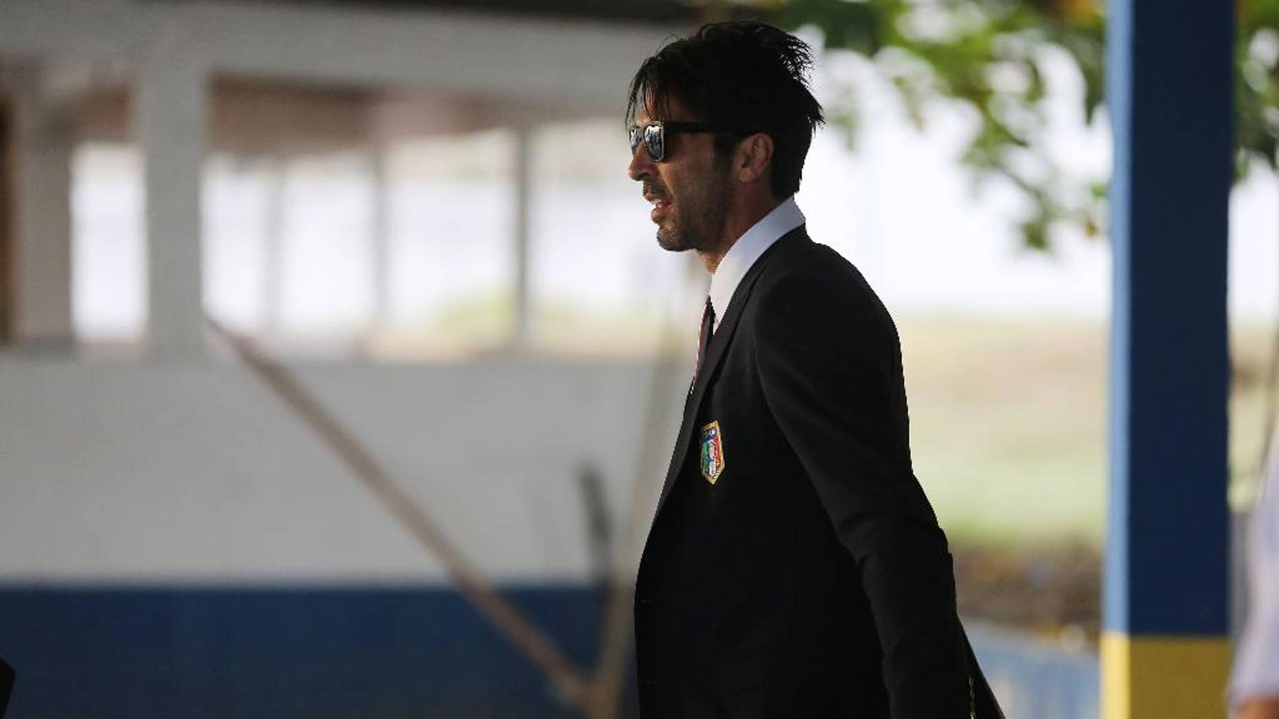 Italy's Gianluigi Buffon walks to his team's bus after arriving to the Galeao Air Base for the World Cup in Rio de Janeiro, Brazil, Friday, June 6, 2014. The Italian team will be based at a resort in Mangaratiba during the  World Cup. (AP Photo/Leo Correa)
