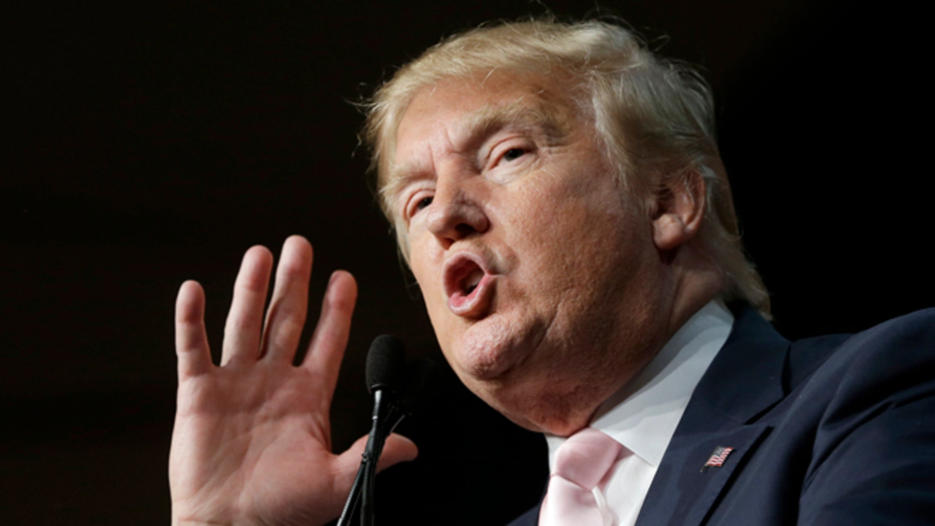 Republican presidential candidate Donald Trump gestures as he addresses supporters during a campaign stop at the Trump National Doral Miami resort, Friday, Oct. 23, 2015 in Doral, Fla. (AP Photo/Alan Diaz)