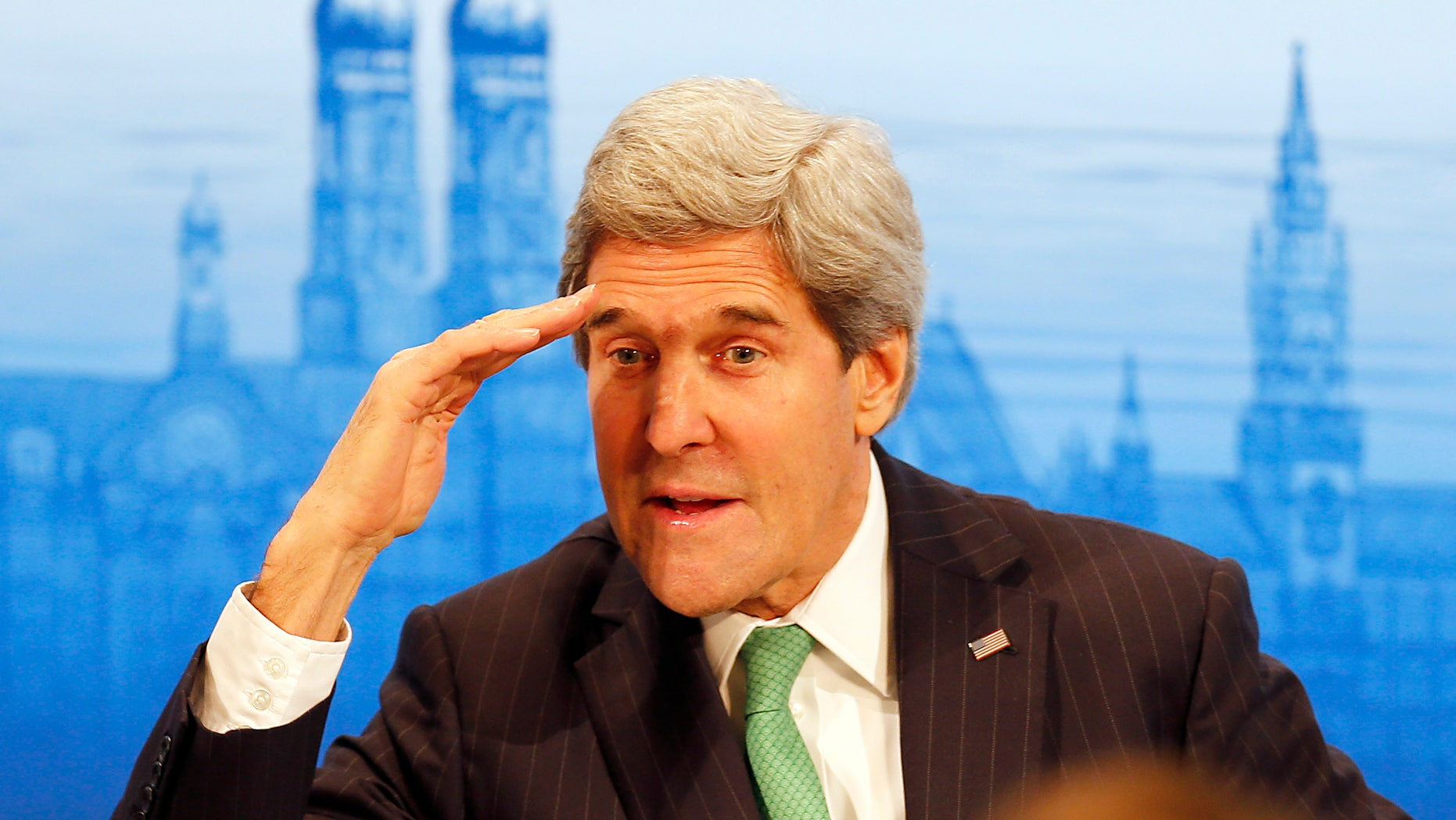 US Secretary of Foreign Affairs John Kerry salutes   as he attends  the 50th Security Conference in Munich, Germany, Saturday, Feb. 1, 2014. The conference on security policy takes place from Jan. 31, 2014 until Feb. 2, 2014. (AP Photo/Frank Augstein)