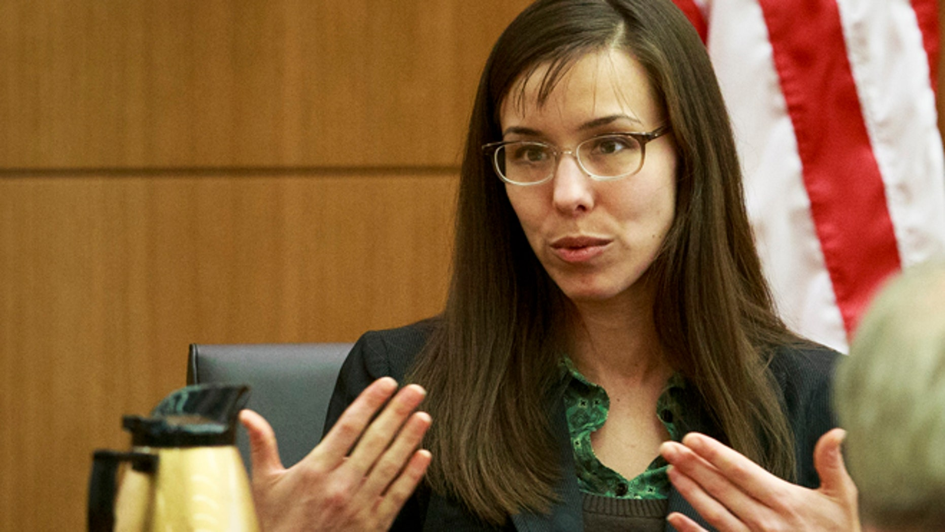 Feb. 6, 2013: Defendant Jodi Arias describes her relationship with Travis Alexander and answers questions from her attorney Kirk Nurmi as she testifies in her murder trial in Judge Sherry Stephens' Superior Court.  Arias, 32, is accused of stabbing and slashing Alexander, 27 times, slitting his throat and shooting him in the head in his suburban Phoenix home in June 2008. She initially denied any involvement, then later blamed it on masked intruders before eventually settling on self-defense. (AP)