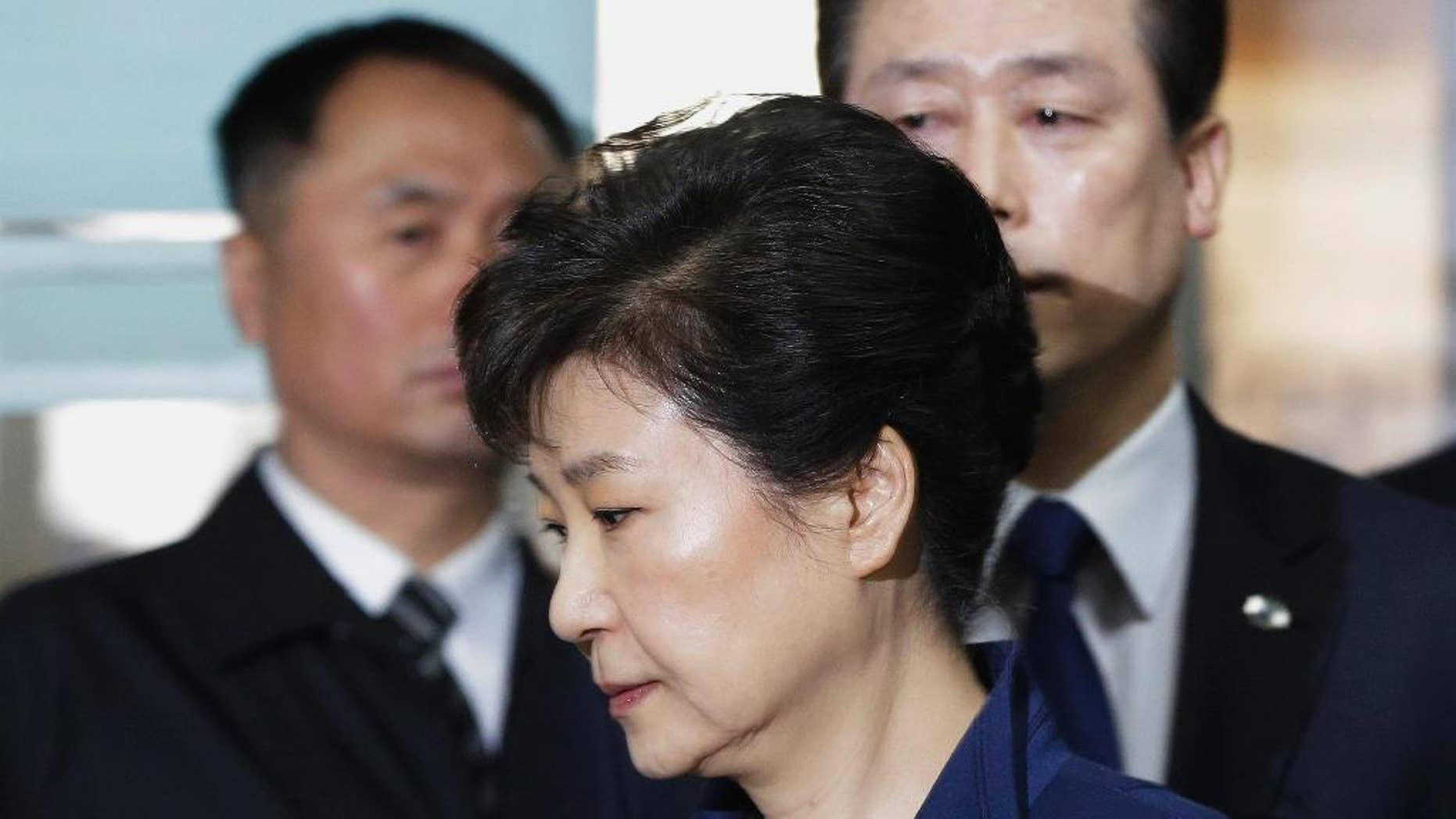 FILE - In this March 30, 2017 file photo, ousted South Korean President Park Geun-hye arrives at the Seoul Central District Court for hearing on a prosecutors' request for her arrest for corruption, in Seoul, South Korea. South Korean prosecutors say they expect to indict former President Park early next week, over corruption allegations. Park has been jailed at a detention center near Seoul since she was arrested late last month over the allegations.  An official at the Seoul prosecutors' office said that Wednesday, April 12, 2017,  that Park will likely be indicted April 17 but didn't elaborate on what charges she will face. (AP Photo/Ahn Young-joon, Pool, File)