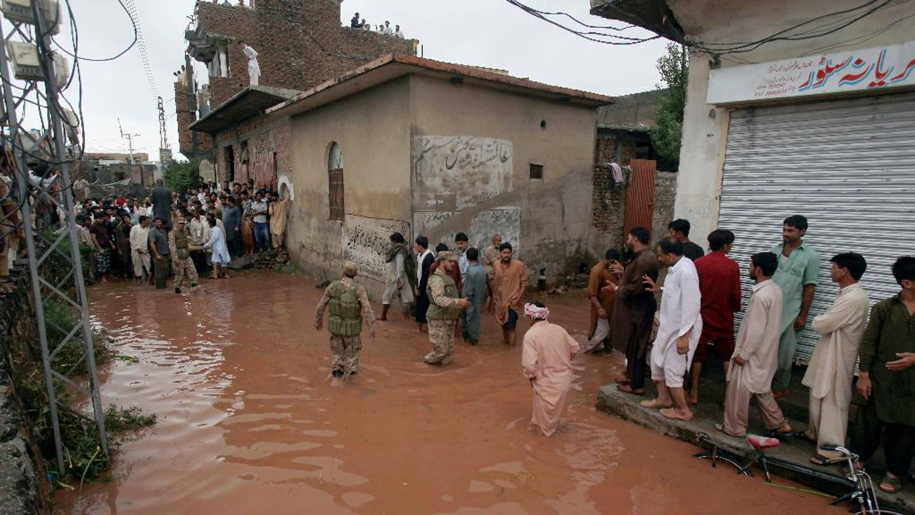Sept. 5, 2014: Pakistani army troops rescue local residents from a flooded area caused by heavy rains on the outskirts of Islamabad, Pakistan.