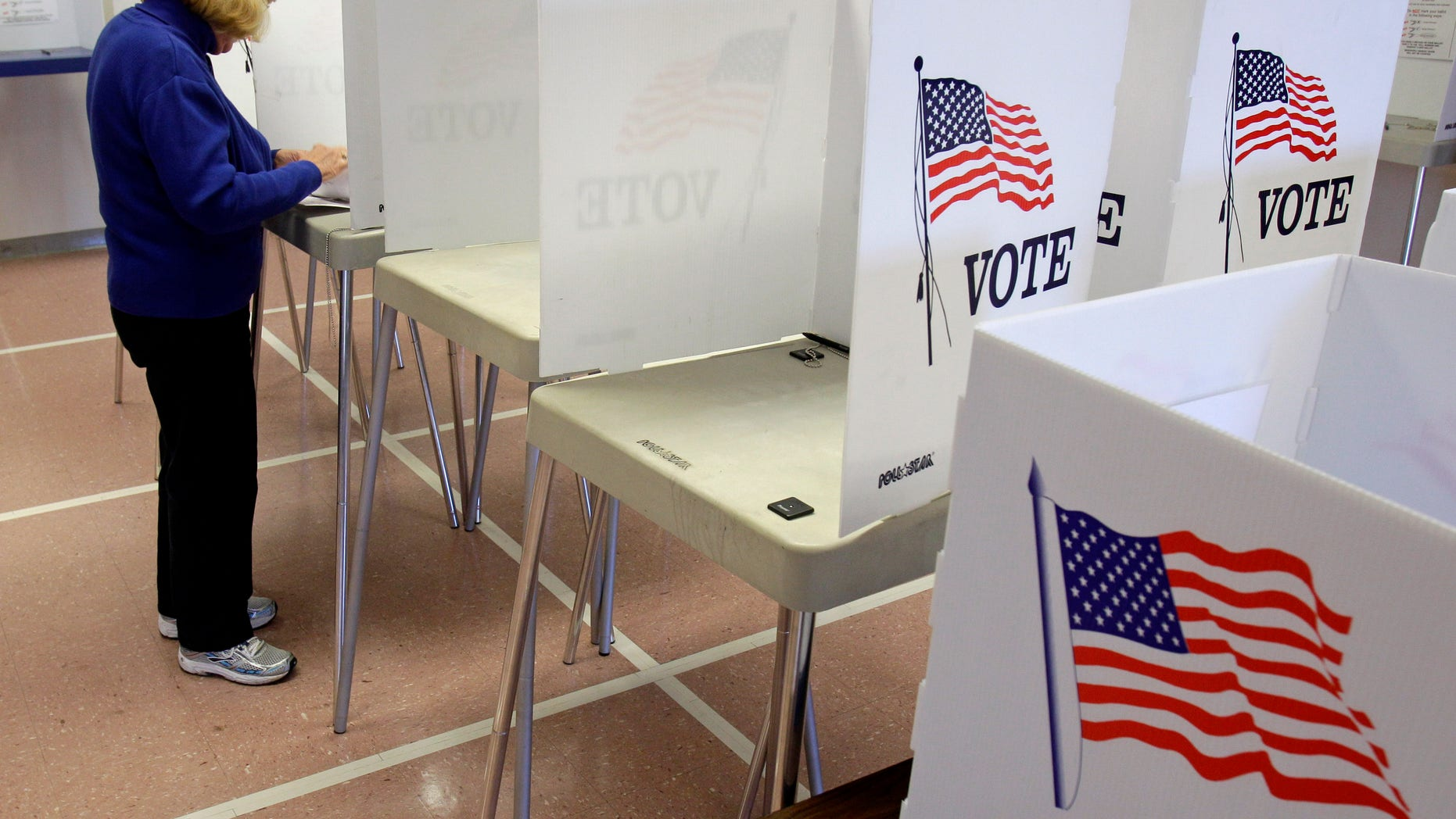 Nancy Suhadolnik of Strongsville, Ohio, votes in early voting Tuesday, Oct. 4, 2011, in Cleveland.