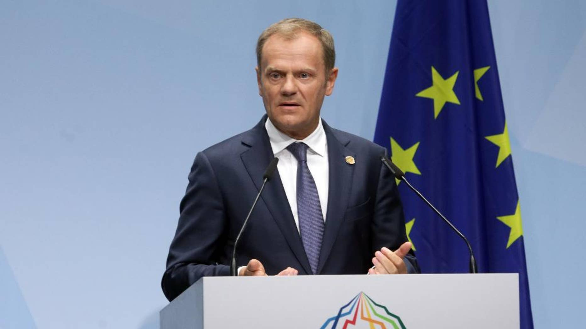 European Council President Donald Tusk speaks during a media conference at the G-7 summit at Schloss Elmau hotel near Garmisch-Partenkirchen, southern Germany, Sunday, June 7, 2015. The two-day summit will address such issues as climate change, poverty and the situation in Ukraine. (AP Photo/Virginia Mayo)