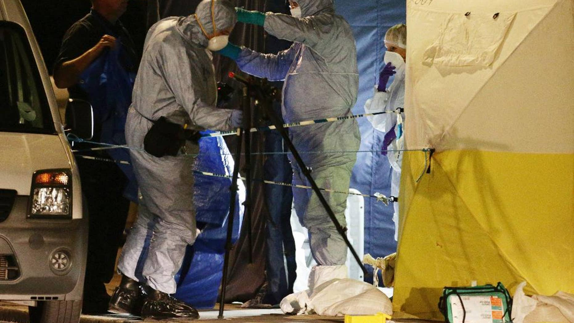 FILE - In this Aug. 4, 2016 file photo, police forensic officers at work in Russell Square, central London, after a knife attack. A teenager has admitted killing a retired Florida teacher and injuring five other people in a stabbing rampage near the British Museum in London. Somali-Norwegian Zakaria Bulhan, 19, pleaded guilty to manslaughter by diminished responsibility in the Aug. 3 slaying of 64-year-old Darlene Horton. He also pleaded guilty to five counts of wounding during a hearing Monday, Feb. 6, 2017 at London's Central Criminal Court. (Yui Mok/PA via AP, file)