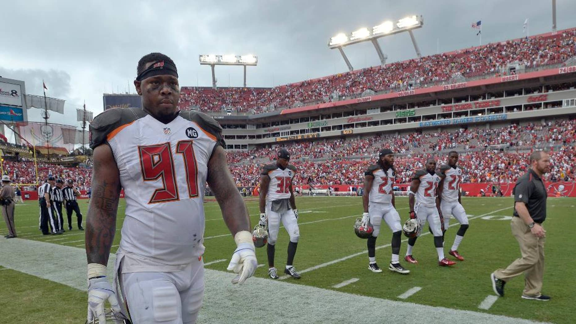 Tampa Bay Buccaneers defensive end Da'Quan Bowers (91) and leave the field during a weather warning in the second quarter of an NFL football game against the St. Louis Rams, Sunday, Sept. 14, 2014, in Tampa, Fla. (AP Photo/Phelan M. Ebenhack)