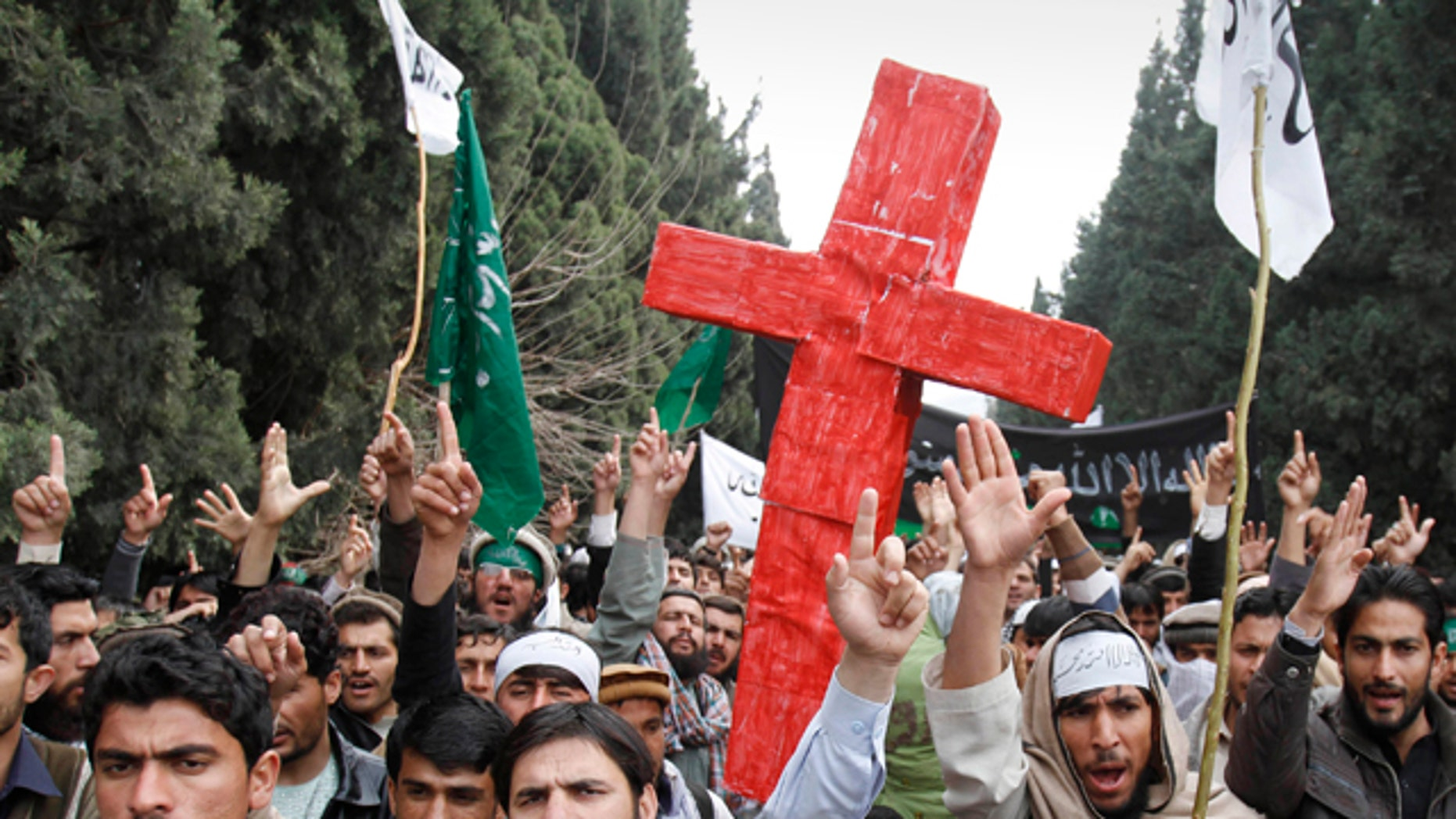 March 13, 2012: Protesters east of Afghanistan's capital of Kabul shout slogans against the United States while carrying a red cross after the killing of 16 Afghan civilians allegedly by an American soldier in Panjwai, in the province of Kandahar.