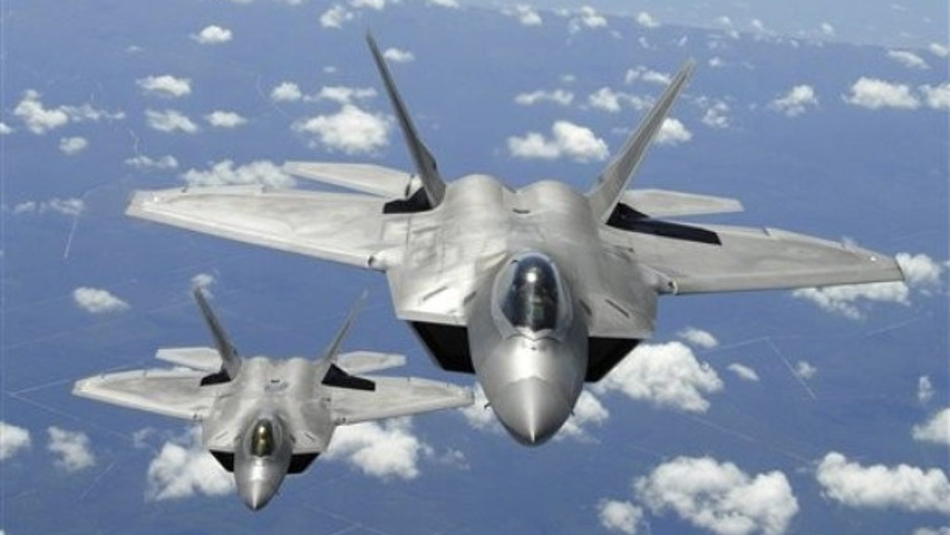 This 2007 image shows two U.S. Air Force F-22 Raptor aircraft during a training mission. The wreckage from a missing F-22 Raptor has been found in Alaska near Denali National Park.