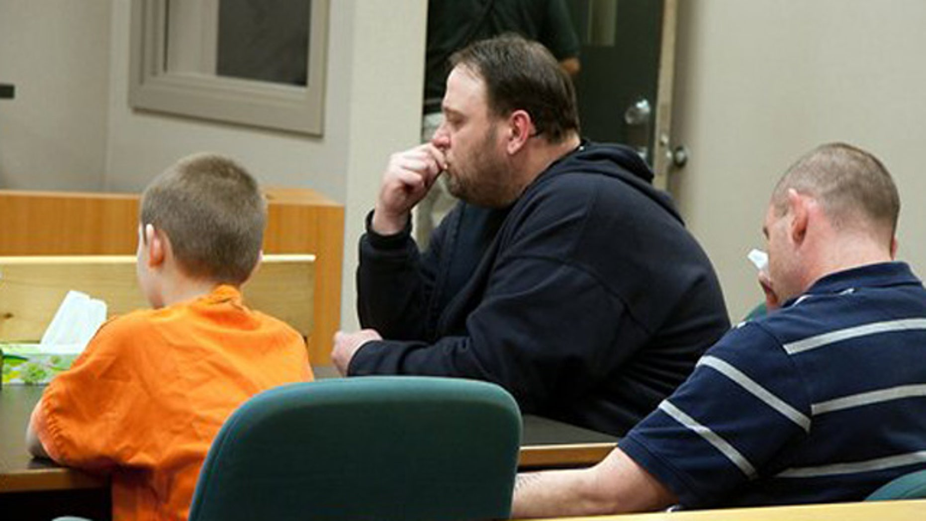 Feb. 23, 2012: The 9-year-old boy accused of accidentally shooting a classmate at a Bremerton, Wash. elementary school, left, appears in Kitsap juvenile court with his uncle and legal guardian, Patrick Cochran, center, and his father, Jason Cochran in Port Orchard, Wash.