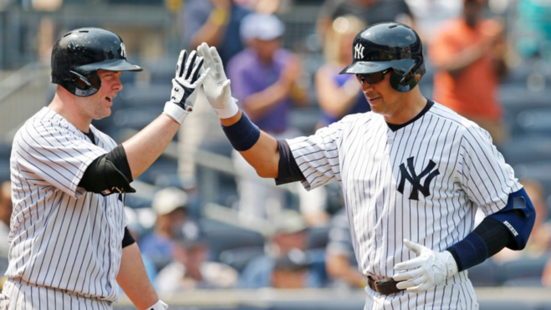 Yankees on-deck batter Brian McCan and Alex Rodriguez at Yankee Stadium in New York, Sunday, July 5, 2015.