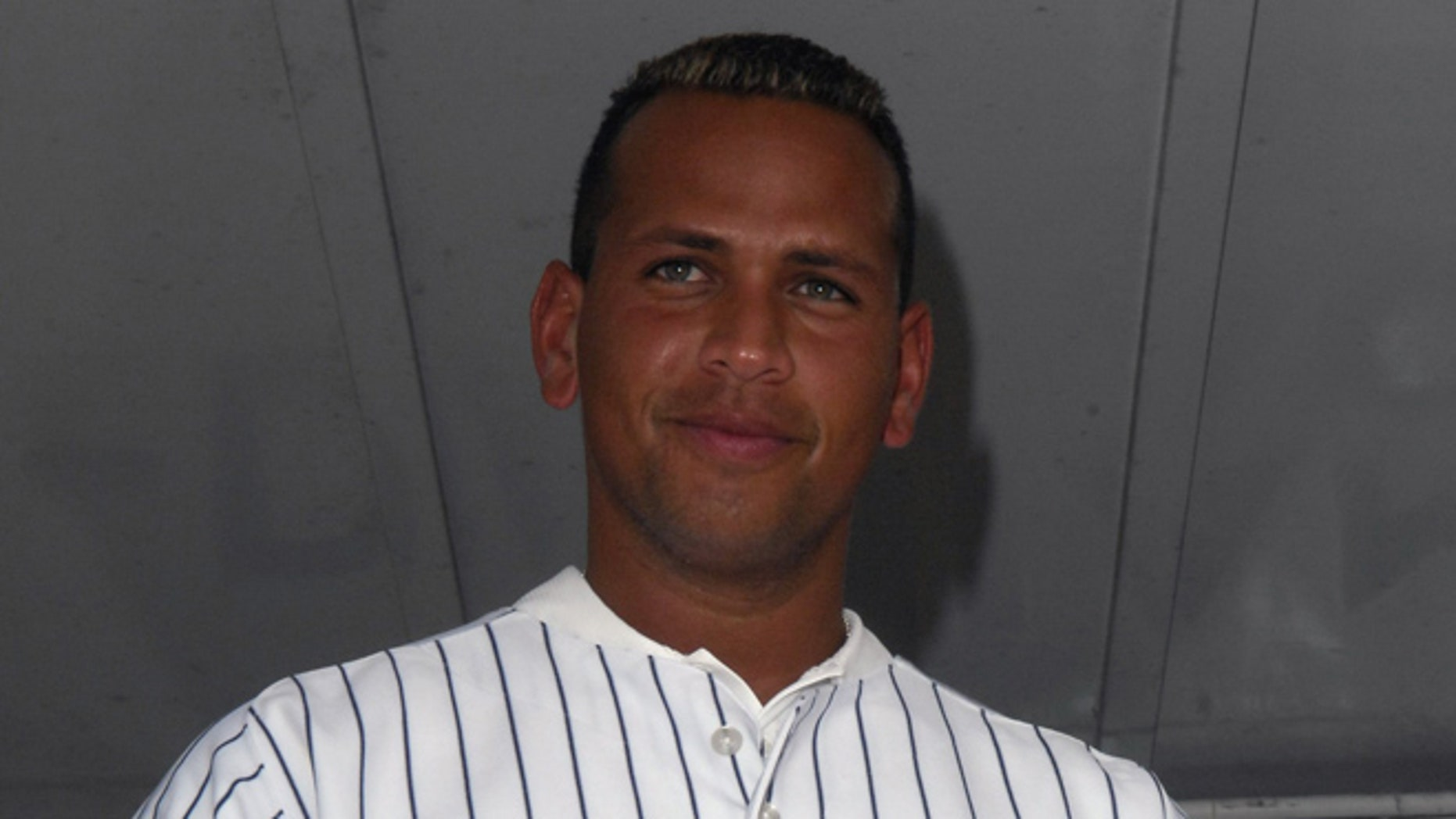 MIAMI , FL - JANUARY 21:   Alex Rodriguez is wearing the jersey that he auctioned off at Family Fun Day benefiting the AROD Family Foundation and Ronald McDonald House Charities at The Miami Seaquarium on January 21, 2007 in Miami, Florida. (Photo by Gustavo Caballero/Getty Images for Arod Corporation)