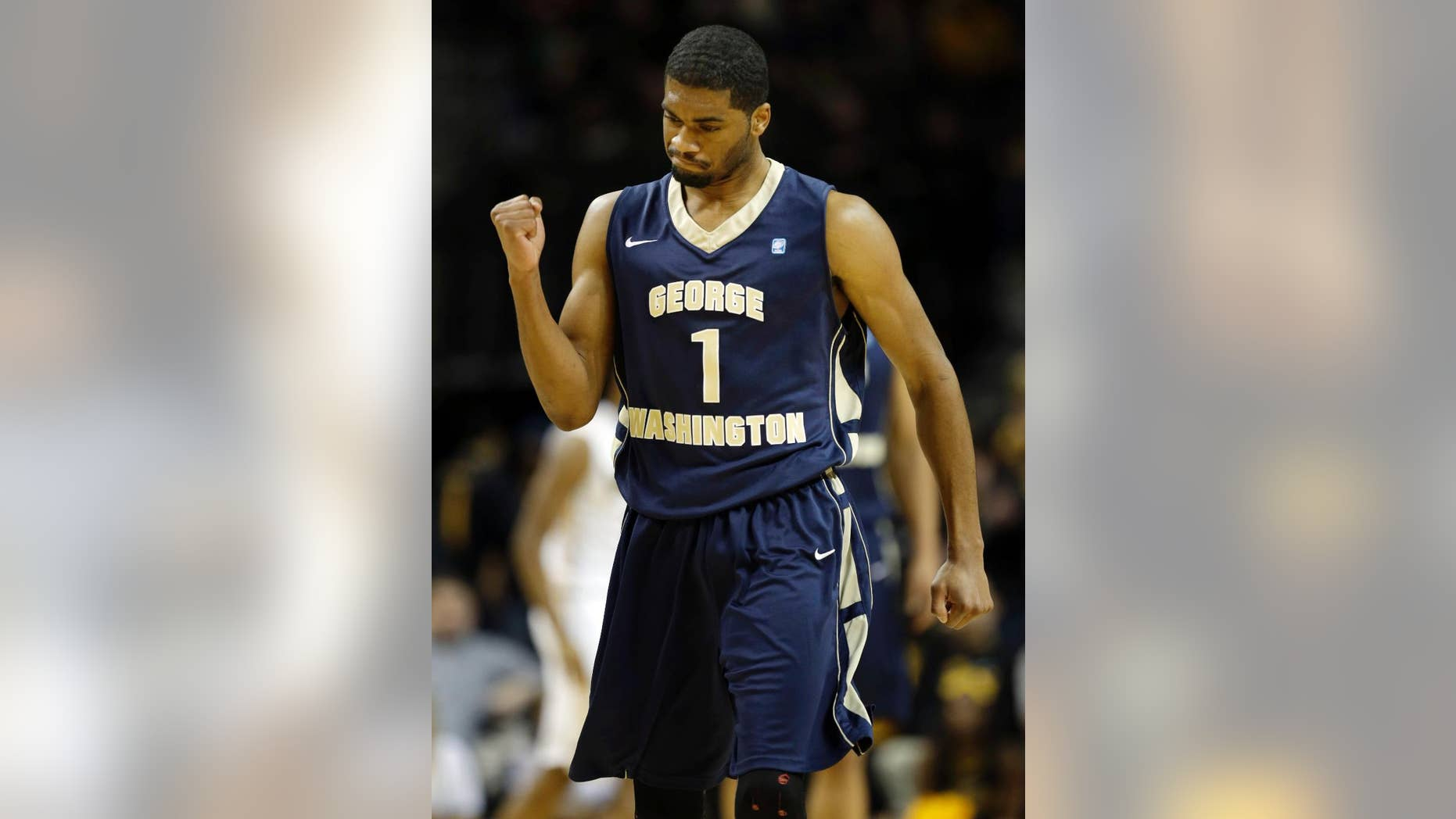 George Washington's Maurice Creek celebrates after his team scored during the first half of an NCAA college basketball game against VCU in the semifinal round of the Atlantic 10 Conference tournament at the Barclays Center in New York, Saturday, March 15, 2014. (AP Photo/Seth Wenig)