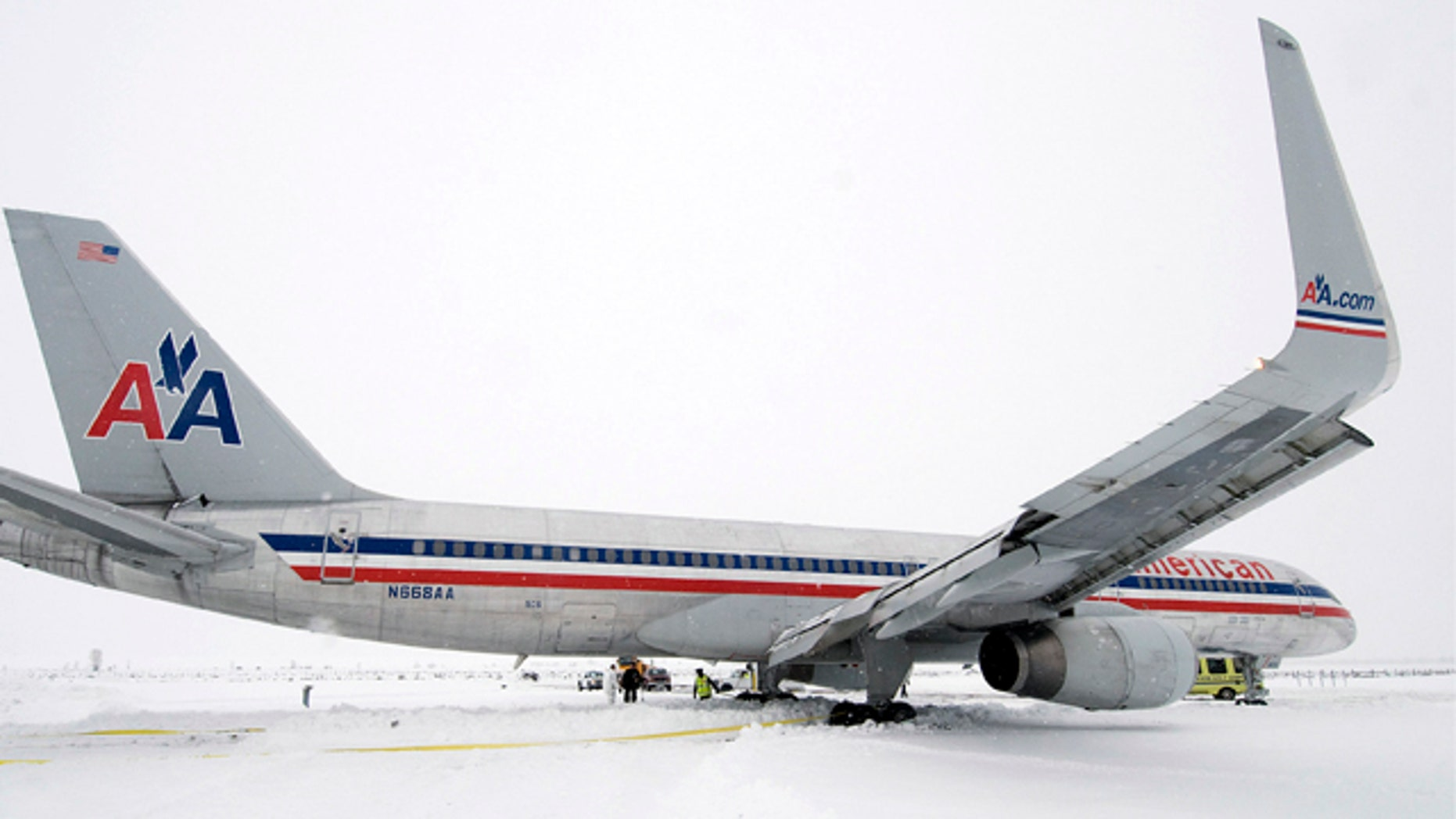 Dec. 29, 2010: Crews work to dig out an American Airlines 757 airplane that slid more than 650 feet off the end of the runway