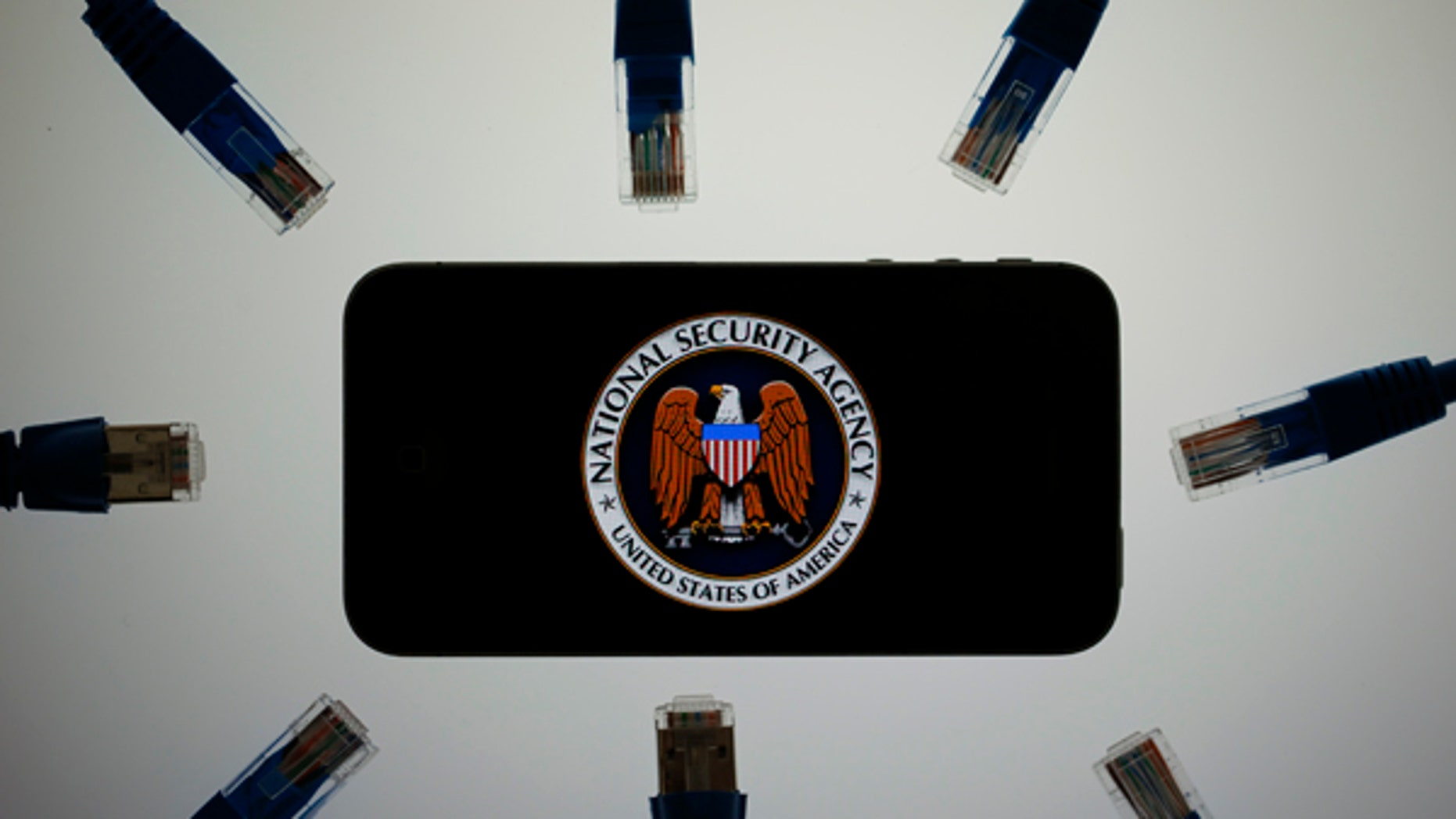 June 7, 2013: An illustration picture shows the logo of the U.S. National Security Agency on the display of an iPhone in Berlin.