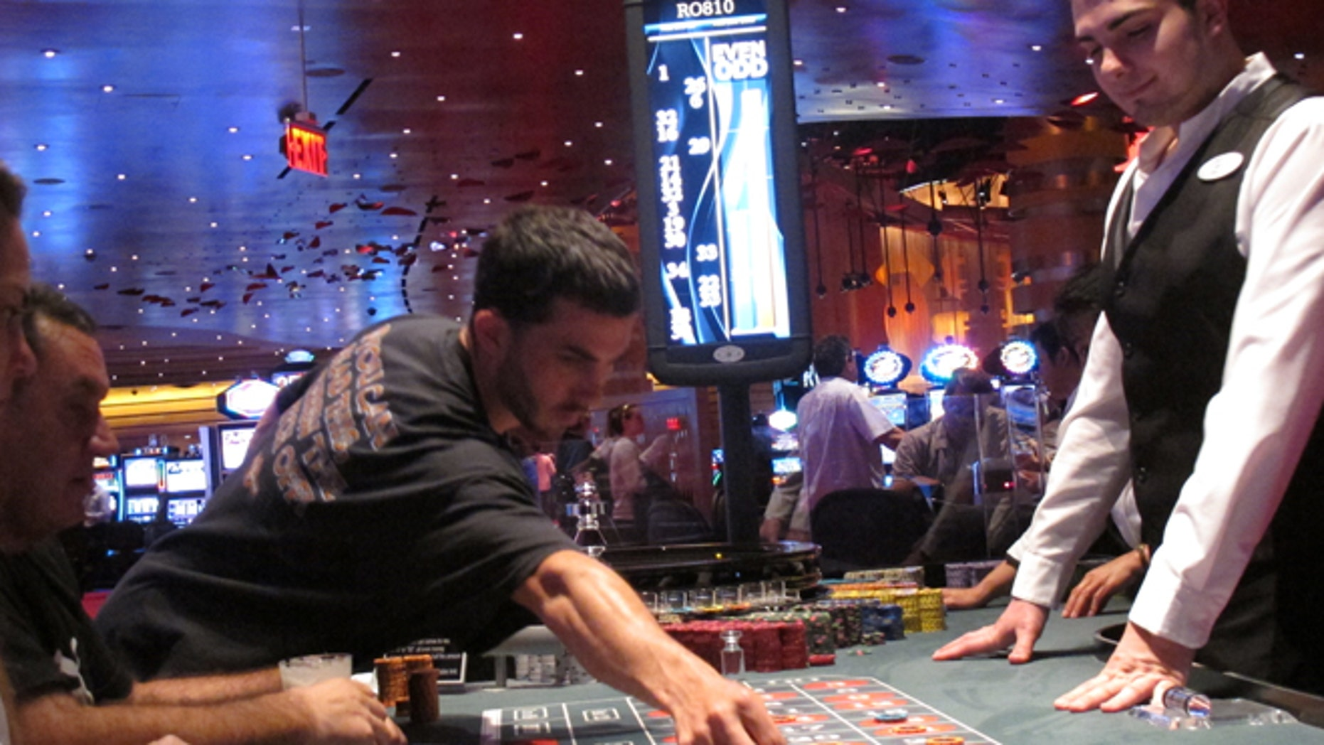 May 21, 2012: A dealer watches as gamblers place bets on a roulette table at Revel Casino Hotel in Atlantic City, N.J. Revel is one of three Atlantic City casinos that could close by September in a wave of casino contraction that could be a glimpse of the future for other parts of the country with too many casinos and not enough gamblers to support them. (AP/Wayne Parry)