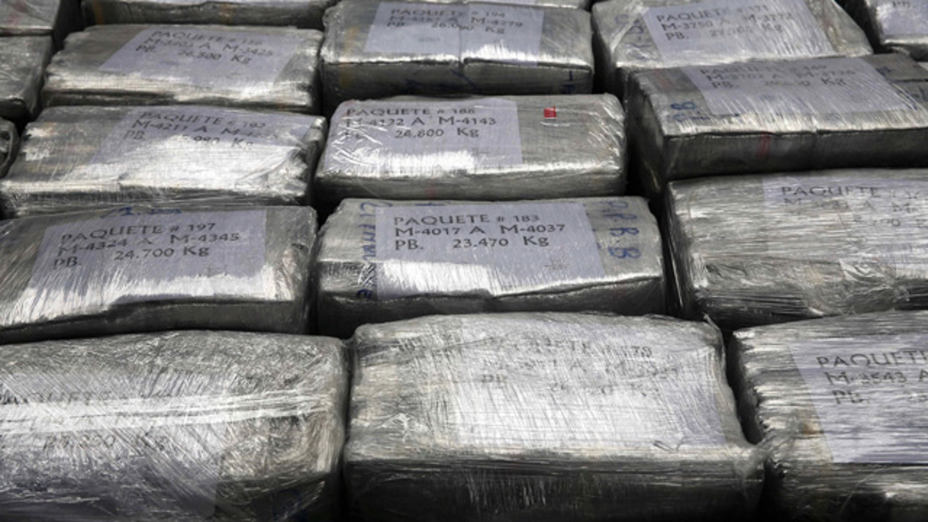 September 1, 2014: Blocks of seized cocaine are presented to the press at a police base in Lima, Peru. According to police, the packages are part of a 8.5 ton cocaine seizure made in the northern town of Trujillo on Aug. 26, and is the largest cocaine seizure in Peru's history. (AP Photo/Martin Mejia)
