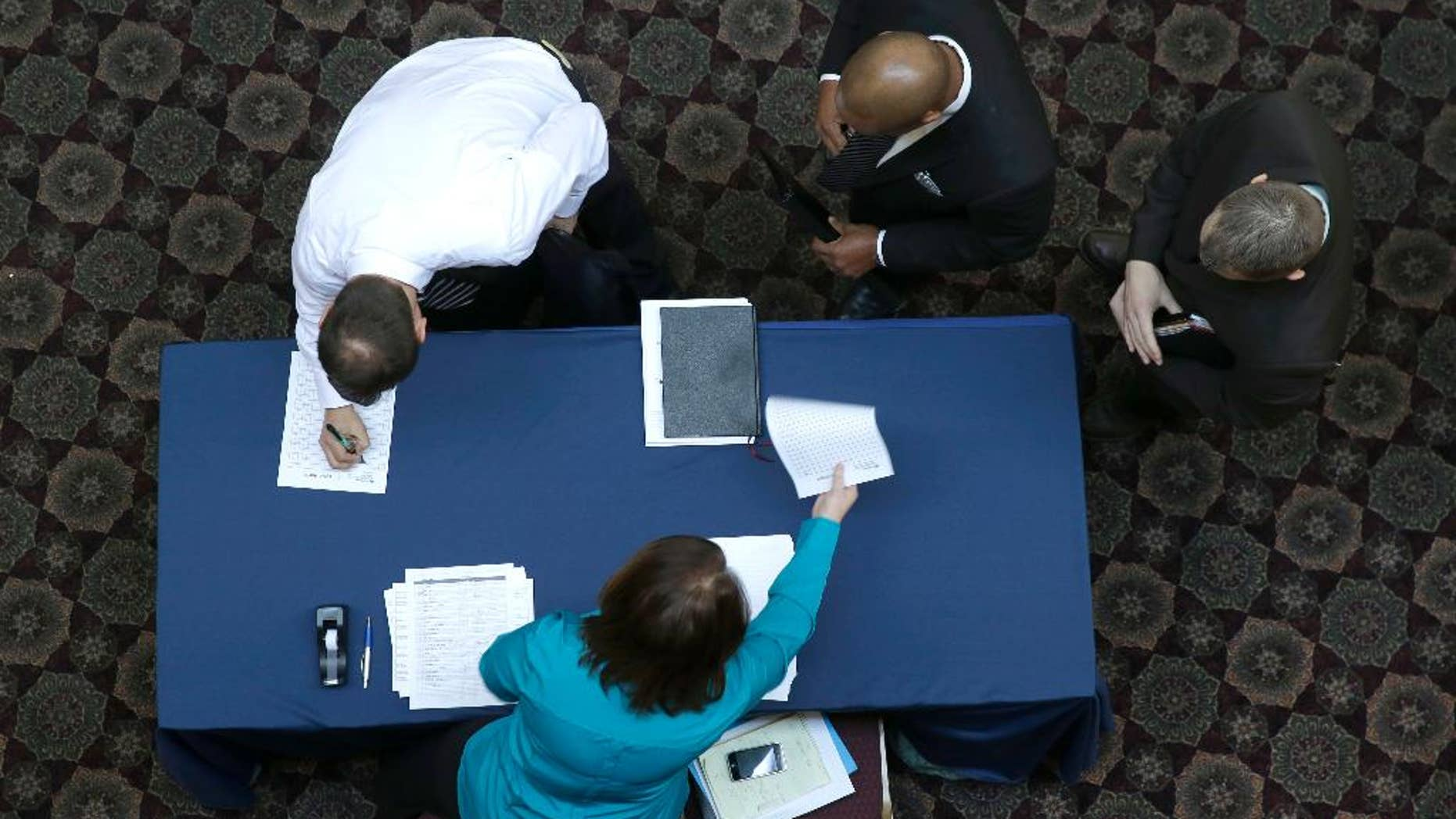FILE - In this Wednesday, Jan. 22, 2014, file photo, job seekers sign in before meeting prospective employers during a career fair at a hotel in Dallas. Payroll processor ADP reports on job growth at U.S. companies in February, on Wednesday, March 5, 2014.  (AP Photo/LM Otero, File)