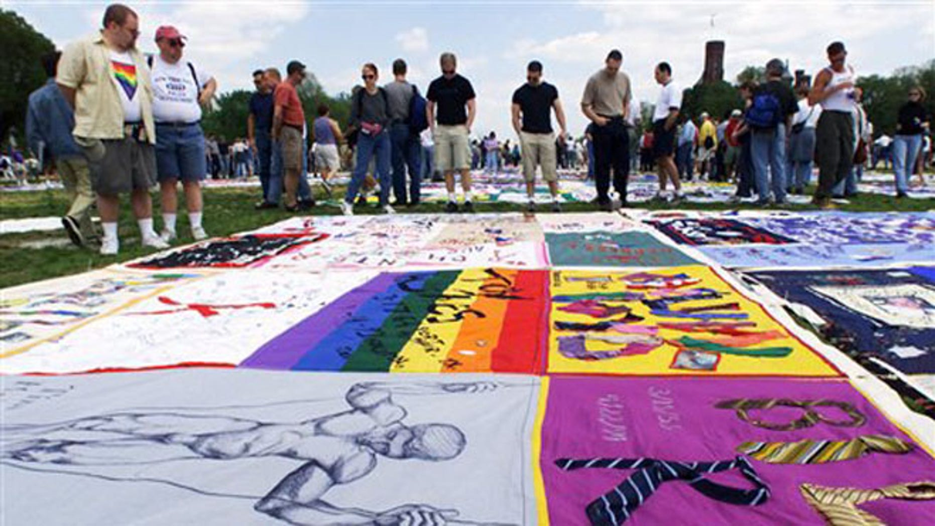 FILE - In this April 29, 2000, file photo visitors look at the new panels to the AIDS Quilt on exhibit on the Washington Mall.