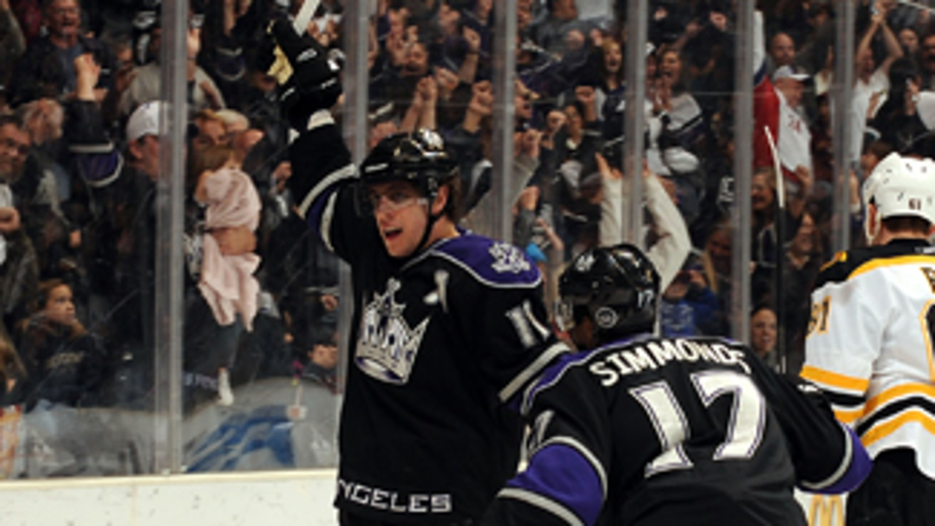 LOS ANGELES, CA - JANUARY 16:  Anze Kopitar #11 of the Los Angeles Kings celebrates after scoring a goal against the Boston Bruins on January 16, 2010 at Staples Center in Los Angeles, California. (Photo by Noah Graham/NHLI via Getty Images) *** Local Caption *** Anze Kopitar