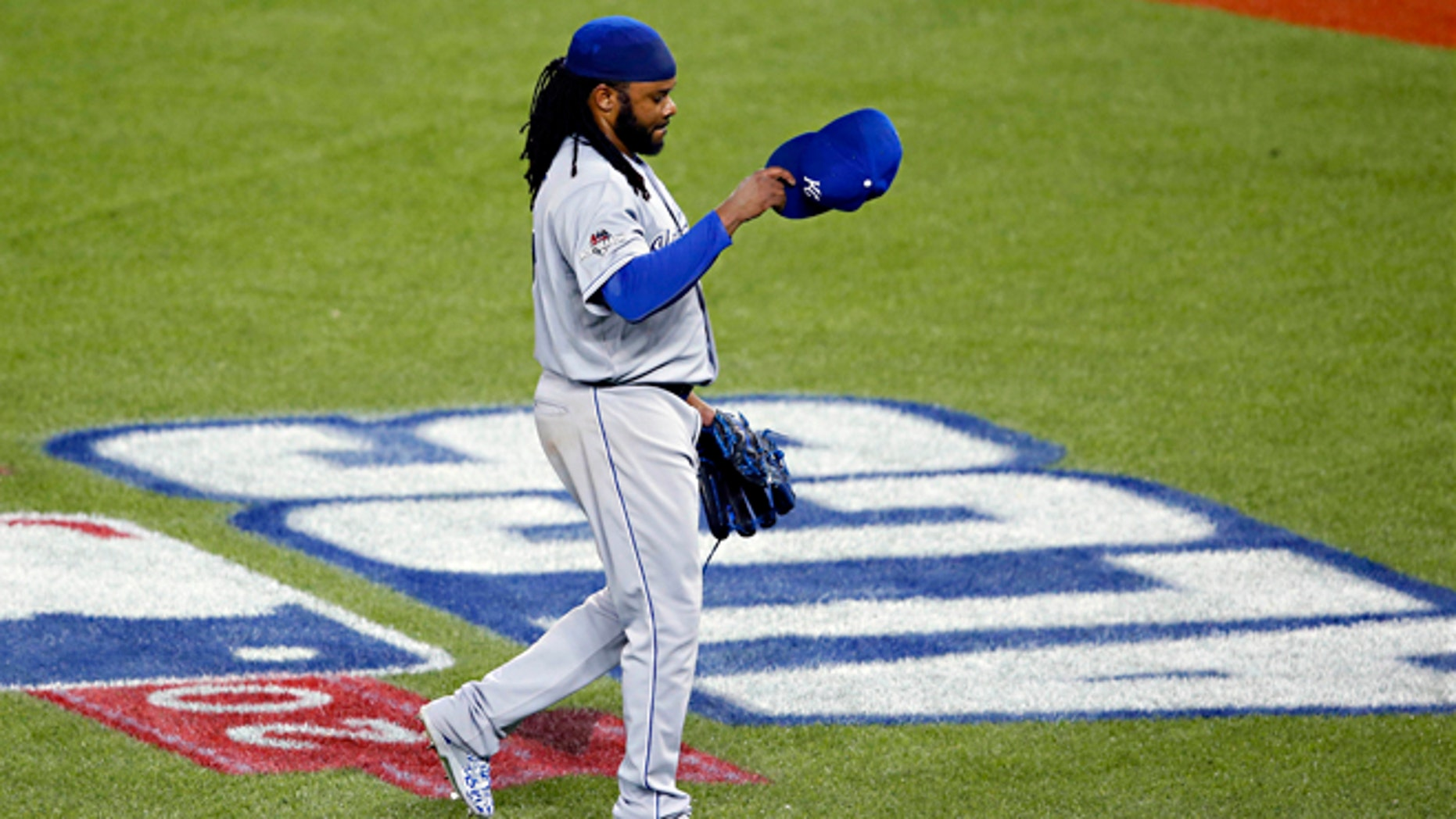 Kansas City Royals starting pitcher Johnny Cueto leaves the game against the Toronto Blue Jays during the third inning in Game 3 of baseball's American League Championship Series on Monday, Oct. 19, 2015, in Toronto. (AP Photo/Paul Sancya)