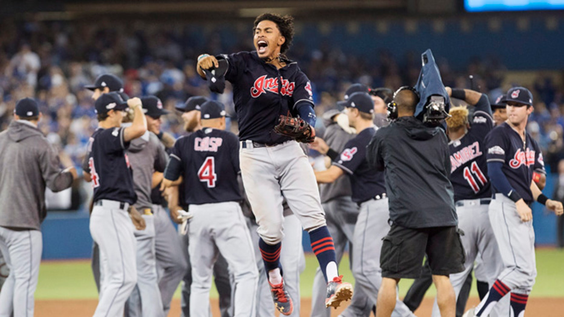 Cleveland Indians shortstop Francisco Lindor celebrates after the Indians defeated the Toronto Blue Jays 3-0 Game 5 of the baseball American League Championship Series in Toronto on Wednesday, Oct. 19, 2016. (Mark Blinch/The Canadian Press via AP)