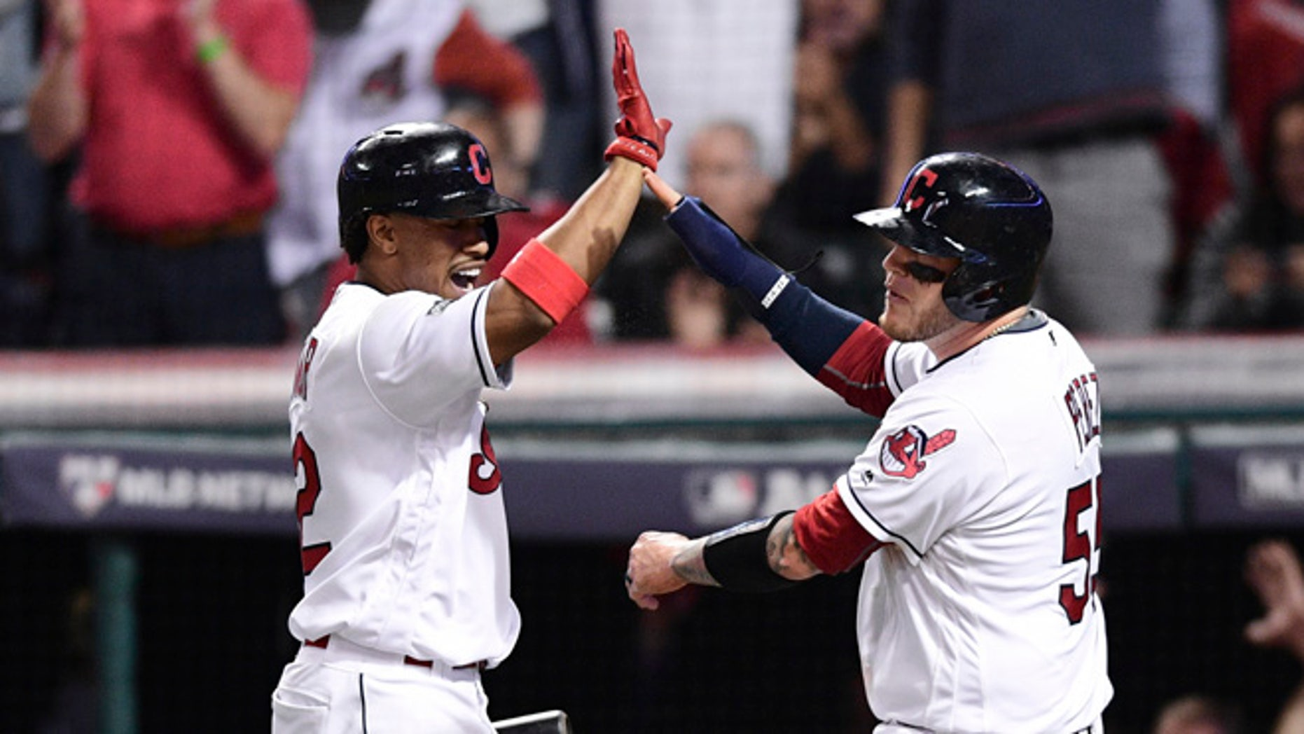Cleveland Indians' Roberto Perez, right, celebrates with Francisco Lindor after scoring on a Jason Kipnis single against the Boston Red Sox in the fifth inning during Game 1 of baseball's American League Division Series, Thursday, Oct. 6, 2016, in Cleveland.