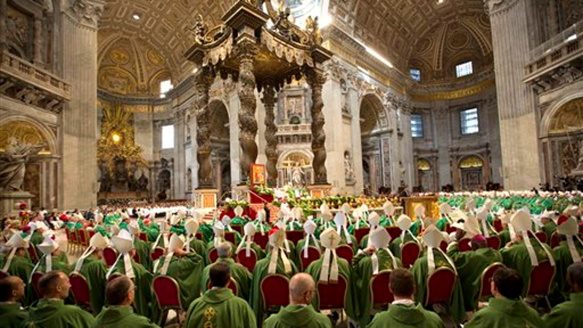 Pope Francis celebrates a Mass to mark the end of the Synod of bishops at the Vatican Sunday. (AP Photo/Alessandra Tarantino)