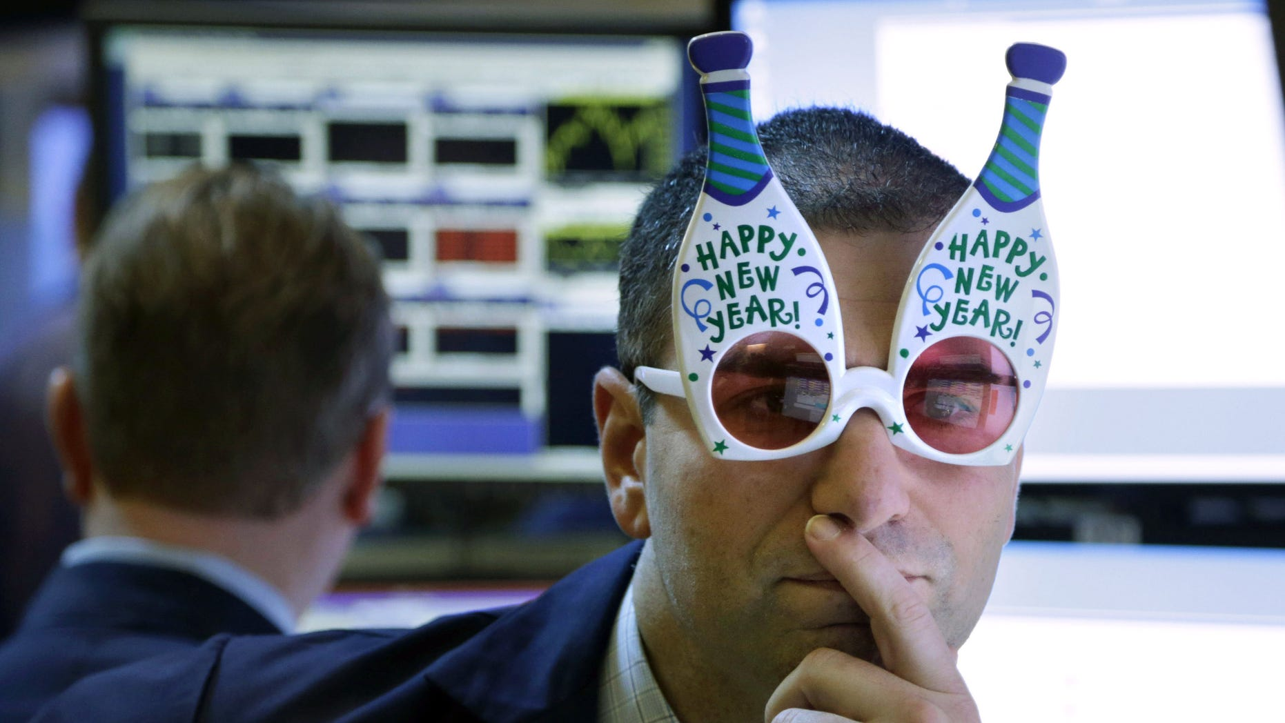 "FILE -  In this Monday, Dec. 31, 2012, file photo, a trader wearing ""Happy New Year"" glasses works on the floor at the New York Stock Exchange in New York. According to an Associated Press-GfK poll released Monday, Dec. 16, 2013,  Americans don't expect another gangbuster year for the stock market. Of the people polled, 40 percent think the market will stabilize at current levels by the end of 2014, with 39 percent predicting that it will drop, but not crash. Only 14 percent believe the market will rise and 5 percent think that the market will crash (AP Photo/Seth Wenig, File)"