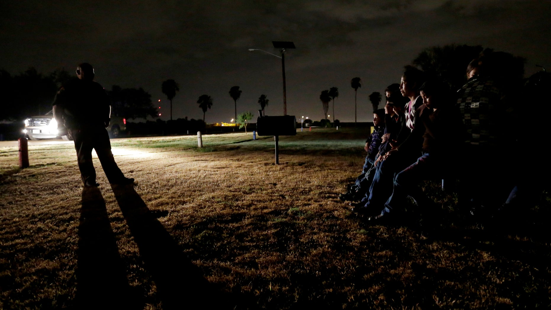 June 25, 2014: A group of immigrants from Honduras and El Salvador, who crossed the U.S.-Mexico border illegally, are stopped in Granjeno, Texas. Just since October, the Border Patrols Rio Grande Valley sector has made more than 194,000 arrests, nearly triple that of any other sector. (AP/Eric Gay)