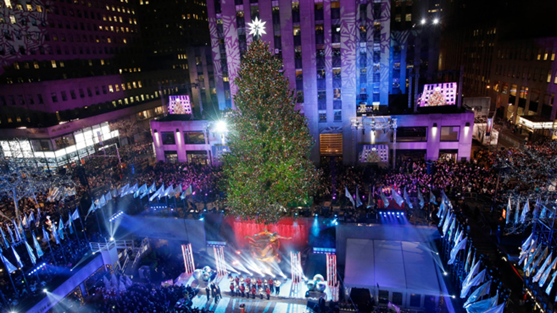 The Rockefeller Center Christmas tree is lit during a ceremony, Wednesday, Dec. 4, 2013, in New York.