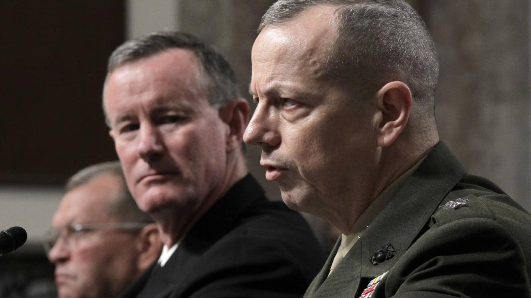 Marine Lt. Gen. John Allen, President Obama's choice to lead the military in Afghanistan, right, testifies on Capitol Hill in Washington, Tuesday, June 28, 2011, before the Senate Armed Services Committee hearing on his nomination. (AP Photo/J. Scott Applewhite)
