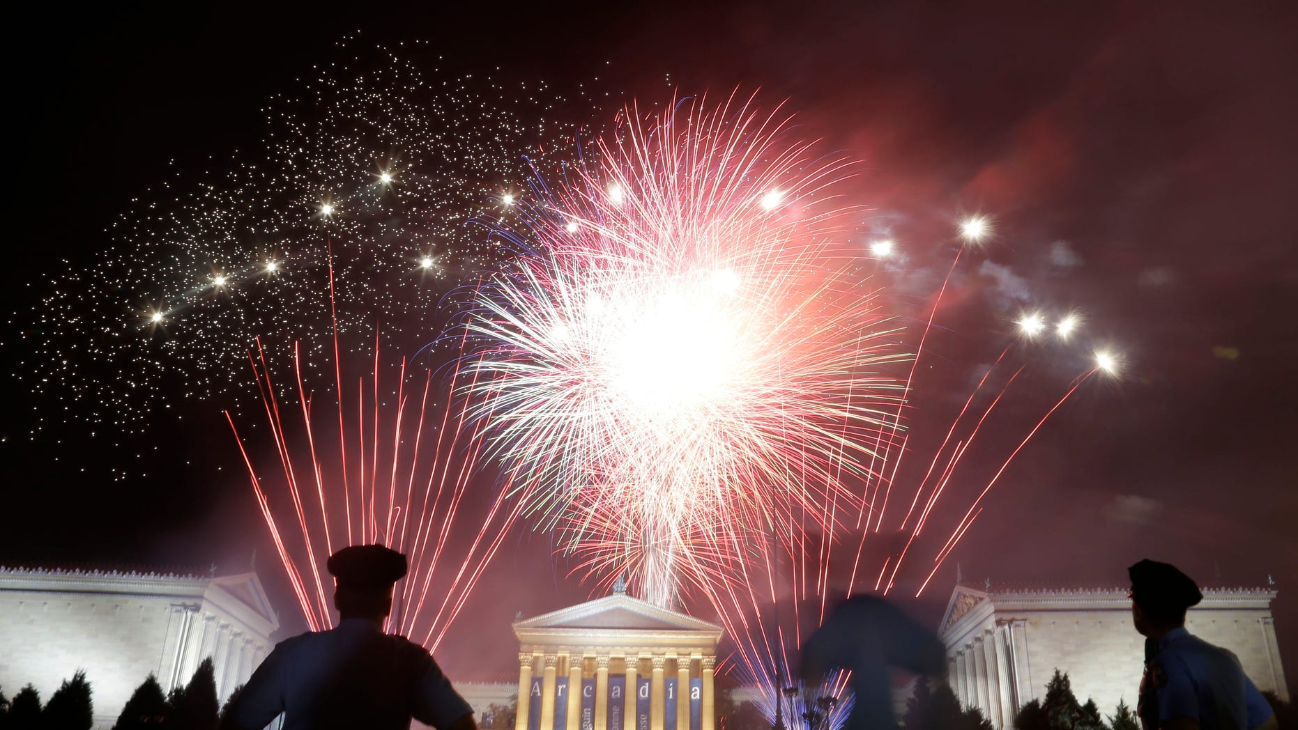 Fireworks light up the sky over the Philadelphia Museum of Art during an Independence Day celebration, Wednesday, July 4, 2012, in Philadelphia. (AP Photo/Matt Rourke)