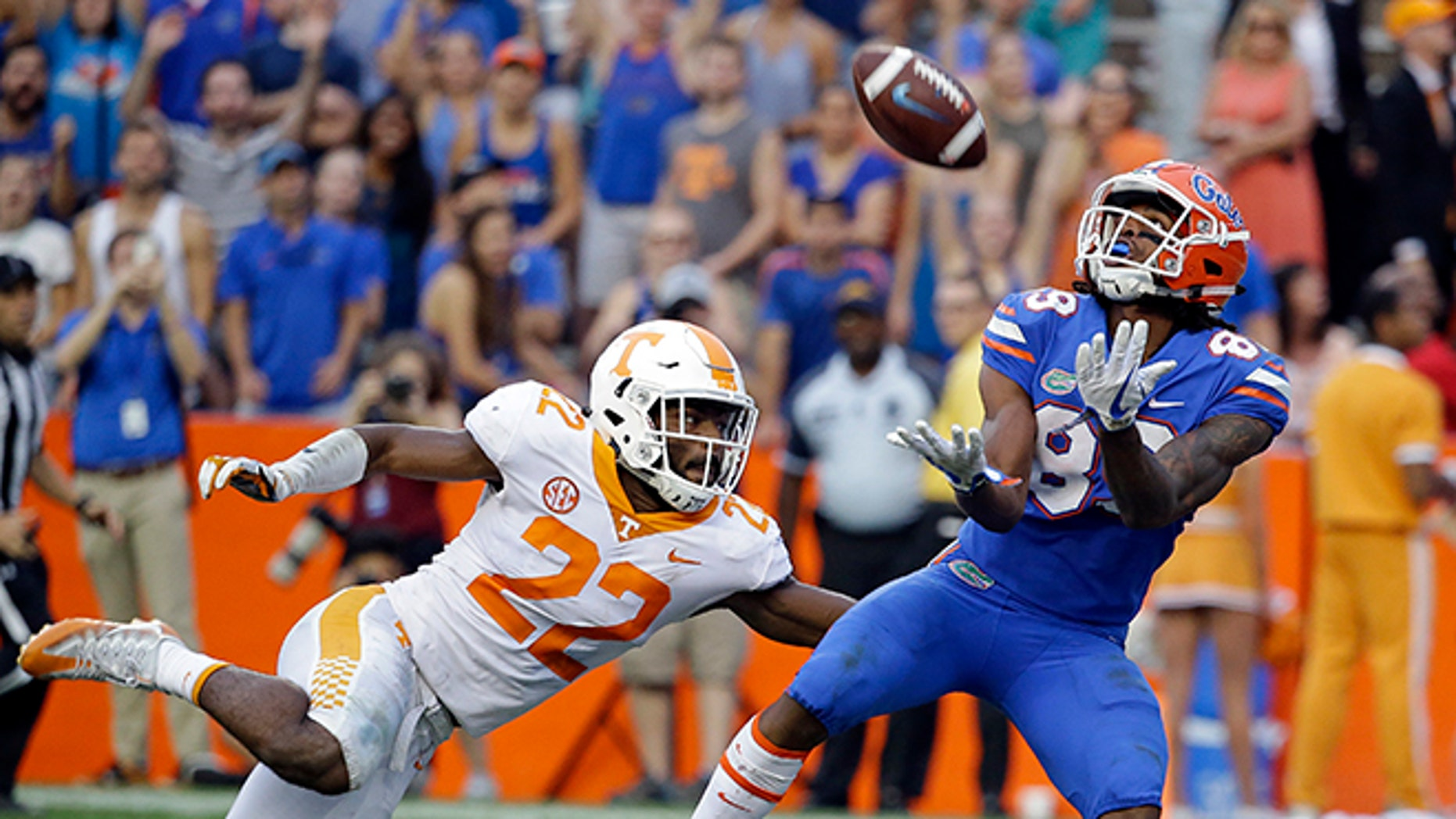 Florida wide receiver Tyrie Cleveland, right, catches the game winning 63-yard touchdown pass in front of Tennessee defensive back Micah Abernathy (22) as time expired in the fourth quarter of an NCAA college football game, Saturday.