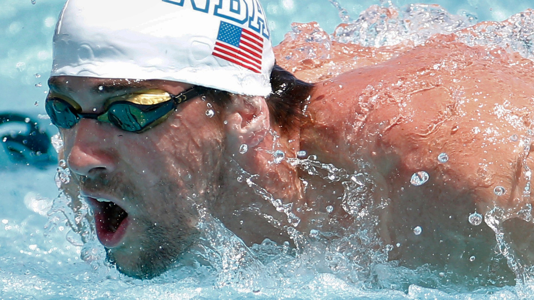 Olympic champion Michael Phelps, shown competing in Arizona in 2014, has challenged pro fighter Colin McGregor to a swimming race.