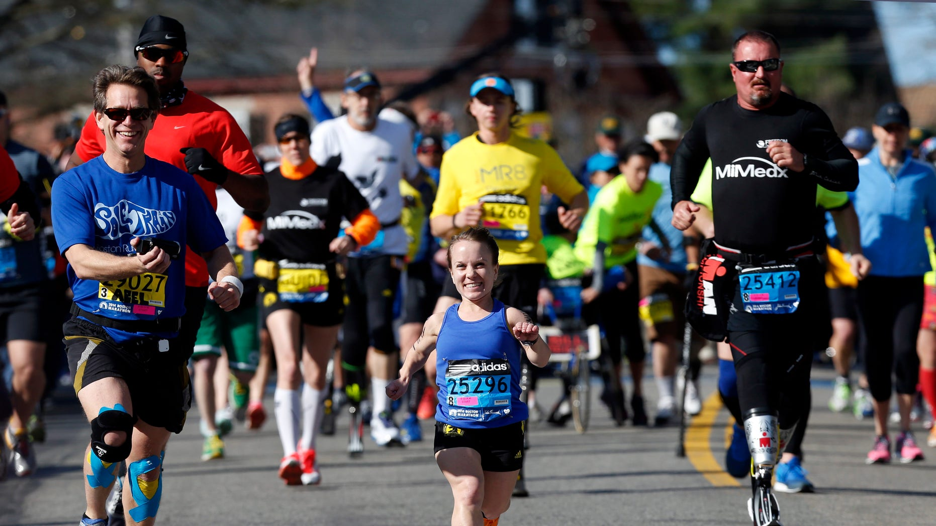 Runners are seen at the Boston Marathon in Hopkinton, Mass.