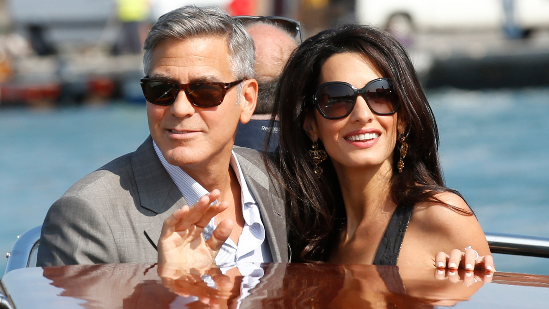 George Clooney, left, and Amal Alamuddin arrive in Venice, Italy, Friday, Sept. 26, 2014.