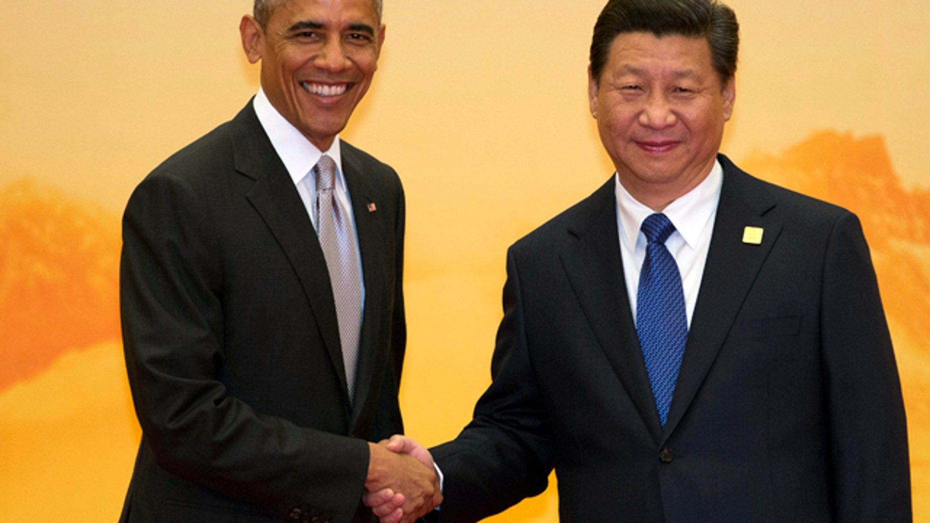 November 11, 2014: U.S. President Barack Obama, left, shakes hands with Chinese President Xi Jinping during a welcome ceremony for the Asia-Pacific Economic Cooperation (APEC) summit at the International Convention Center in Yanqi Lake, Beijing. (AP Photo/Ng Han Guan)