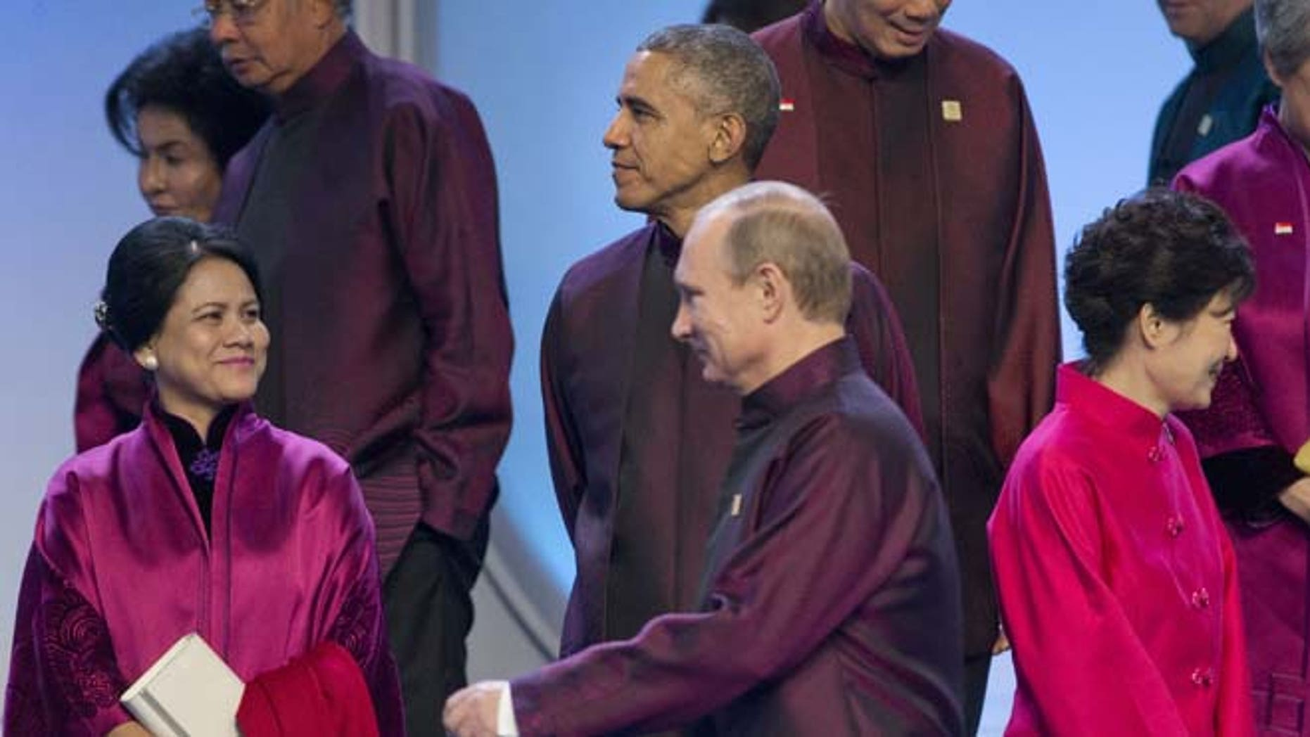 This Monday, Nov. 10, 2014 photo shows Russian President Vladimir Putin and President Barack Obama during the Asia-Pacific Economic Cooperation (APEC) Summit family photo in Beijing.
