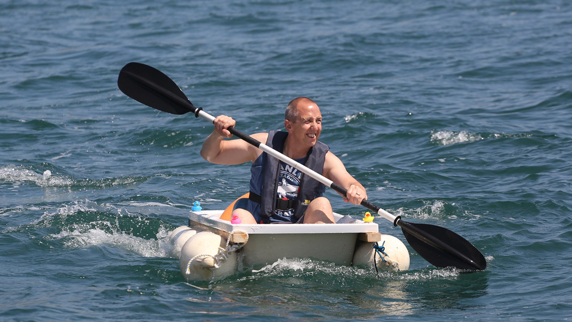 Plumber Iain Bevan, 51, rows across seas at Torbay inside a bath tub to raise money for charity.
