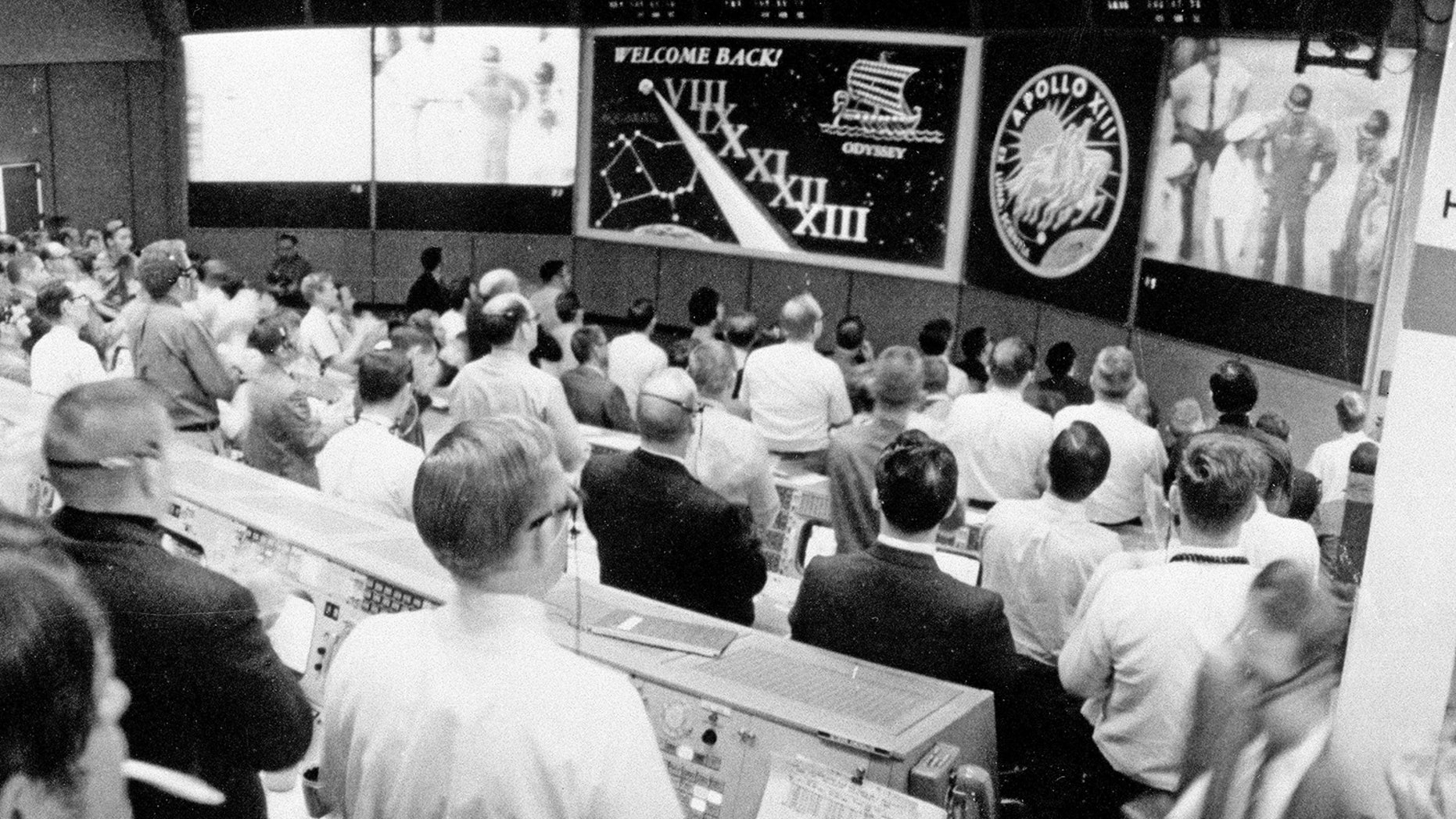 The view from NASA's Mission Operations Control Room as the Apollo 13 crew is welcomed aboard the USS Iwo Jima on April 17, 1970 following a perilous flight around the moon by astronauts James Lovell, Fred Haise and Jack Swigert.