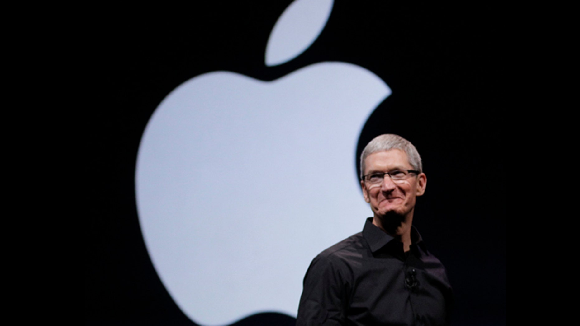 Sept. 12, 2012: Apple CEO Tim Cook walks on stage at the beginning of an event in San Francisco, where the company is expected to announce a new iPhone.