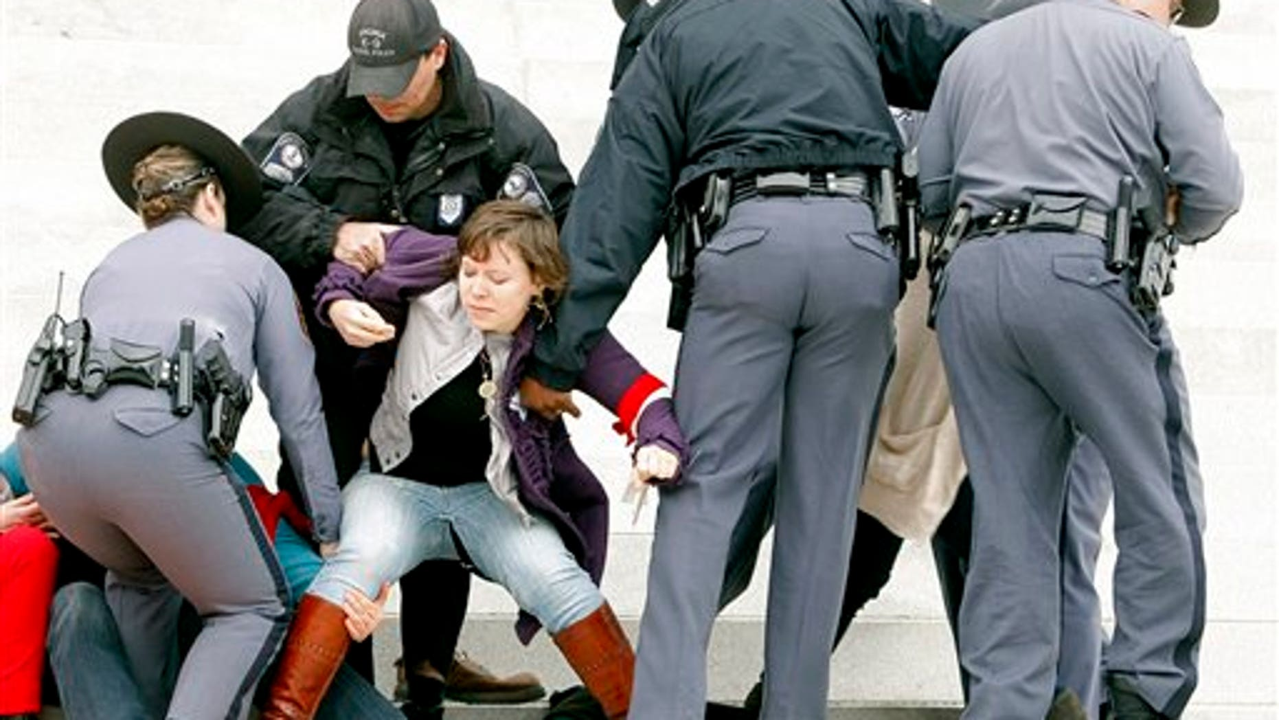 March 3: Protesters are removed from the front steps of the State Capitol in Richmond, Va.