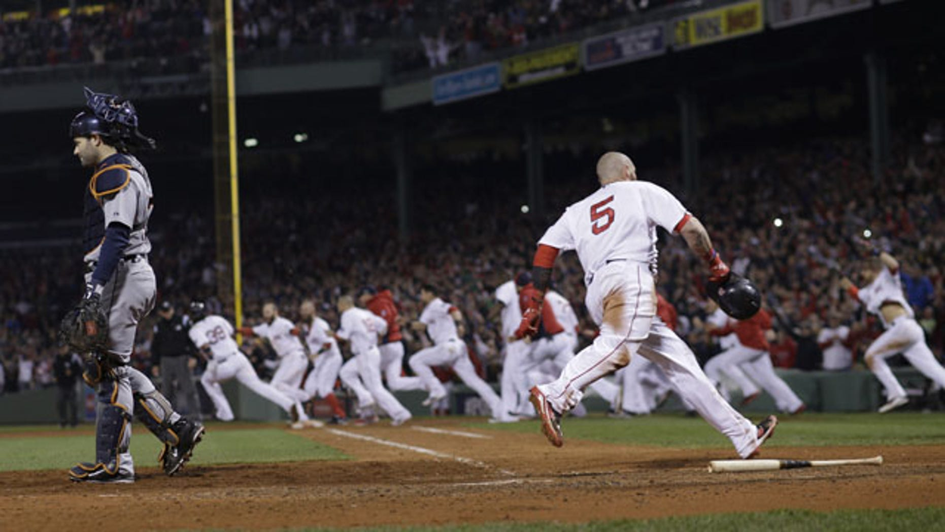 October 13, 2013: Boston Red Sox's Jonny Gomes scores the winning run on a hit by Jarrod Saltalamacchia during Game 2 of the American League baseball championship series against the Detroit Tigers Sunday in Boston. (AP Photo)