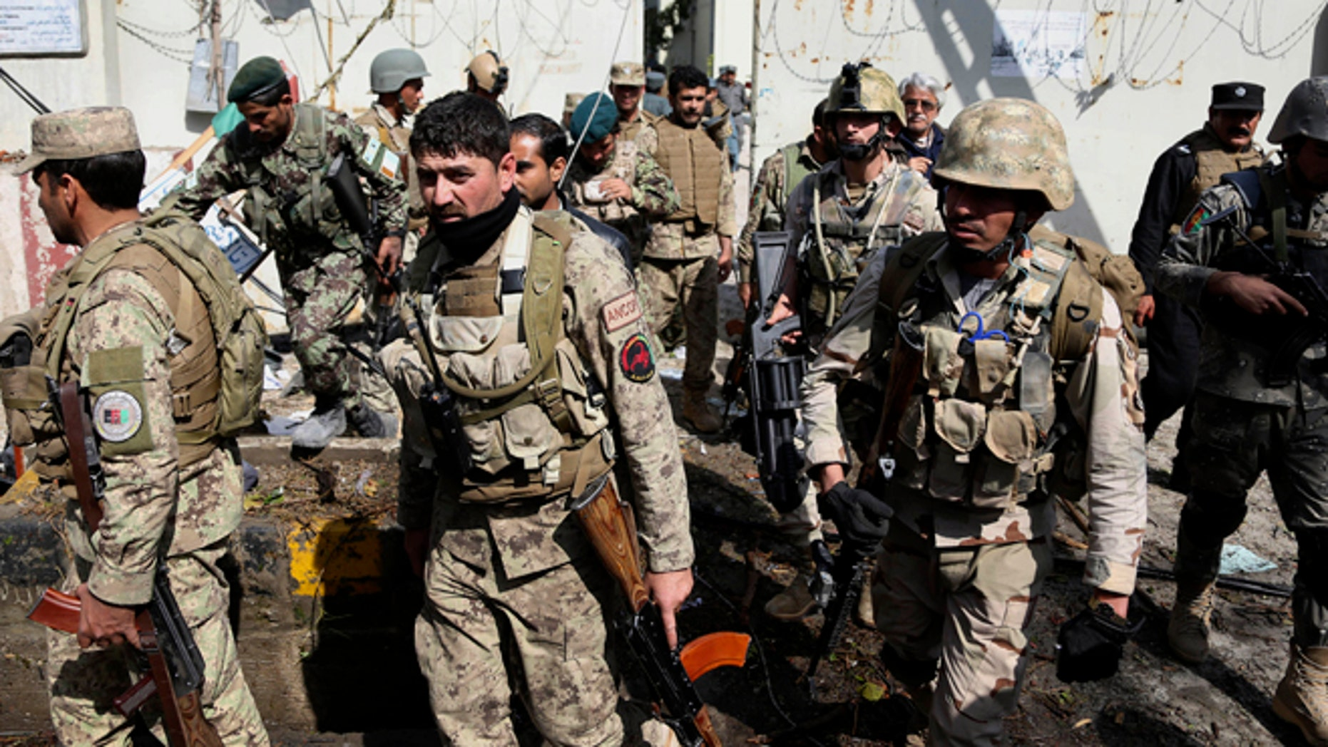 March 20, 2014: Afghan Army and police search through a police station after the Taliban staged a multi-pronged attack on a police station in Jalalabad, eastern Afghanistan.