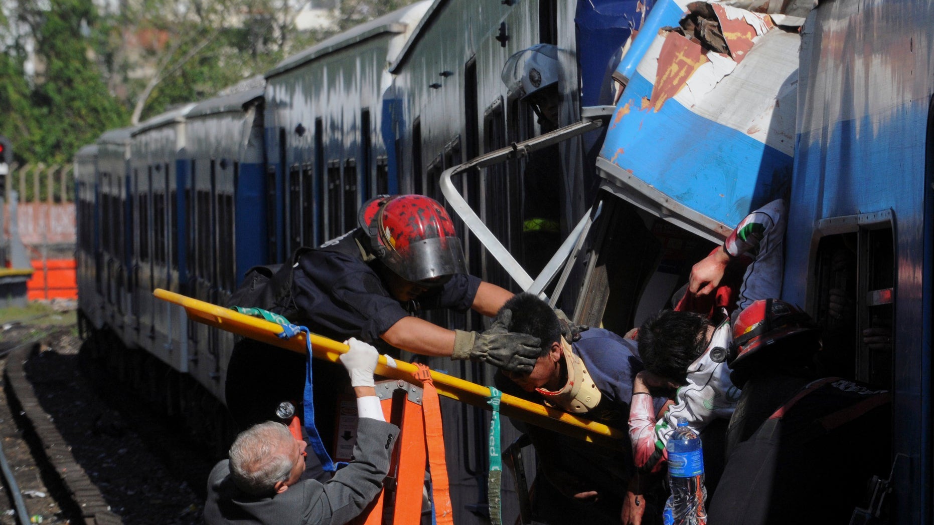 Feb. 22, 2012: Firemen rescue wounded passengers from a commuter train after a collision in Buenos Aires, Argentina.