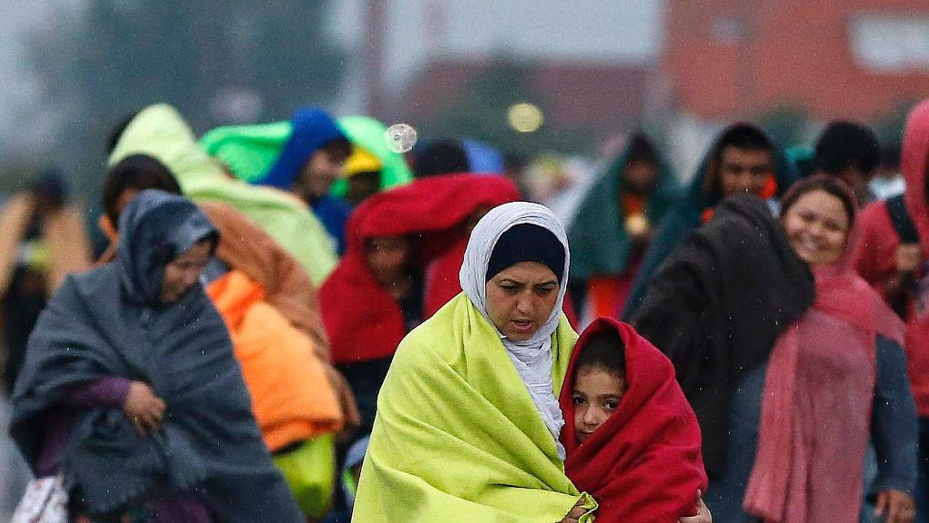 Migrants arrive at the Hungarian-Austrian border in Nickelsdorf, Austria, Saturday, Sept. 5, 2015, where they came from Budapest as Austria in the early-morning hours said it and Germany would let them in.