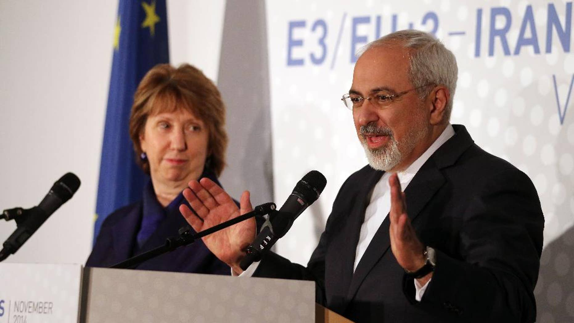 Former European foreign policy chief Catherine Ashton, left, and Iranian Foreign Minister Mohamad Javad Zarif, right, address the media after closed-door nuclear talks in Vienna, Austria, Monday, Nov. 24, 2014.  Facing still significant differences between the U.S. and Iran, negotiators gave up on last-minute efforts to get a nuclear deal by the Monday deadline and extended their talks for another seven months. (AP Photo/Ronald Zak)